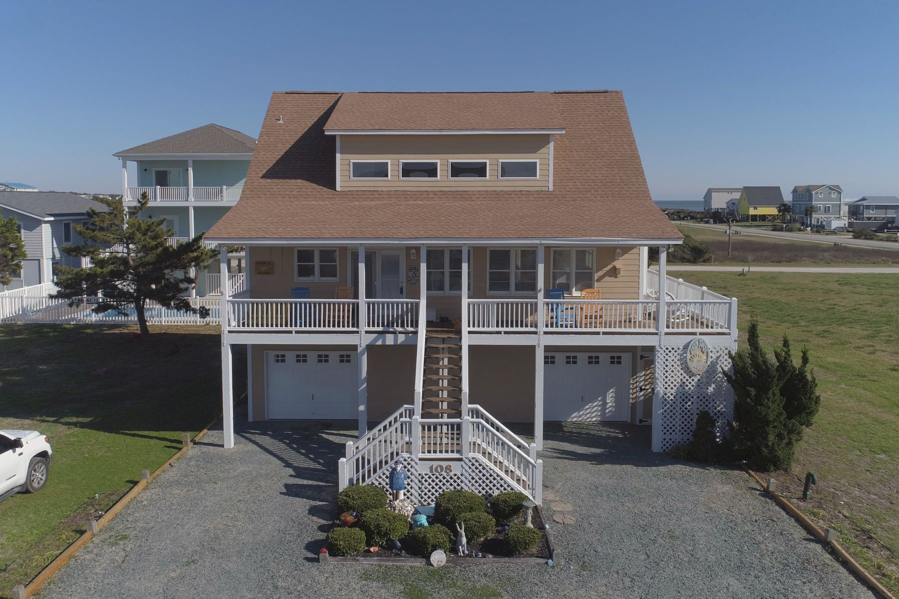 Single Family Homes for Sale at Bright and Breezy Beach Living 108 Conch Street Holden Beach, North Carolina 28462 United States