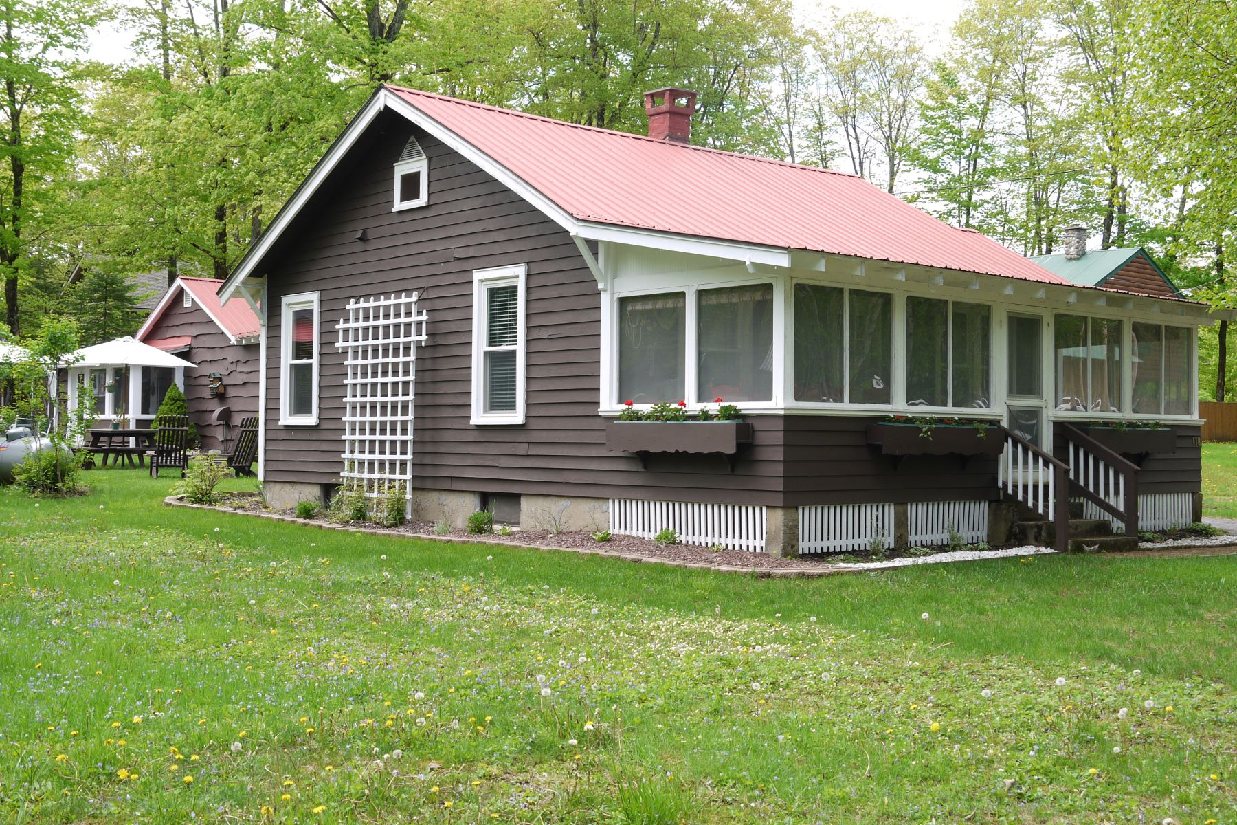 Multi-Family Homes for Sale at 2 Year round homes in the Eagle Bay Park 118 East Ave Eagle Bay, New York 13331 United States