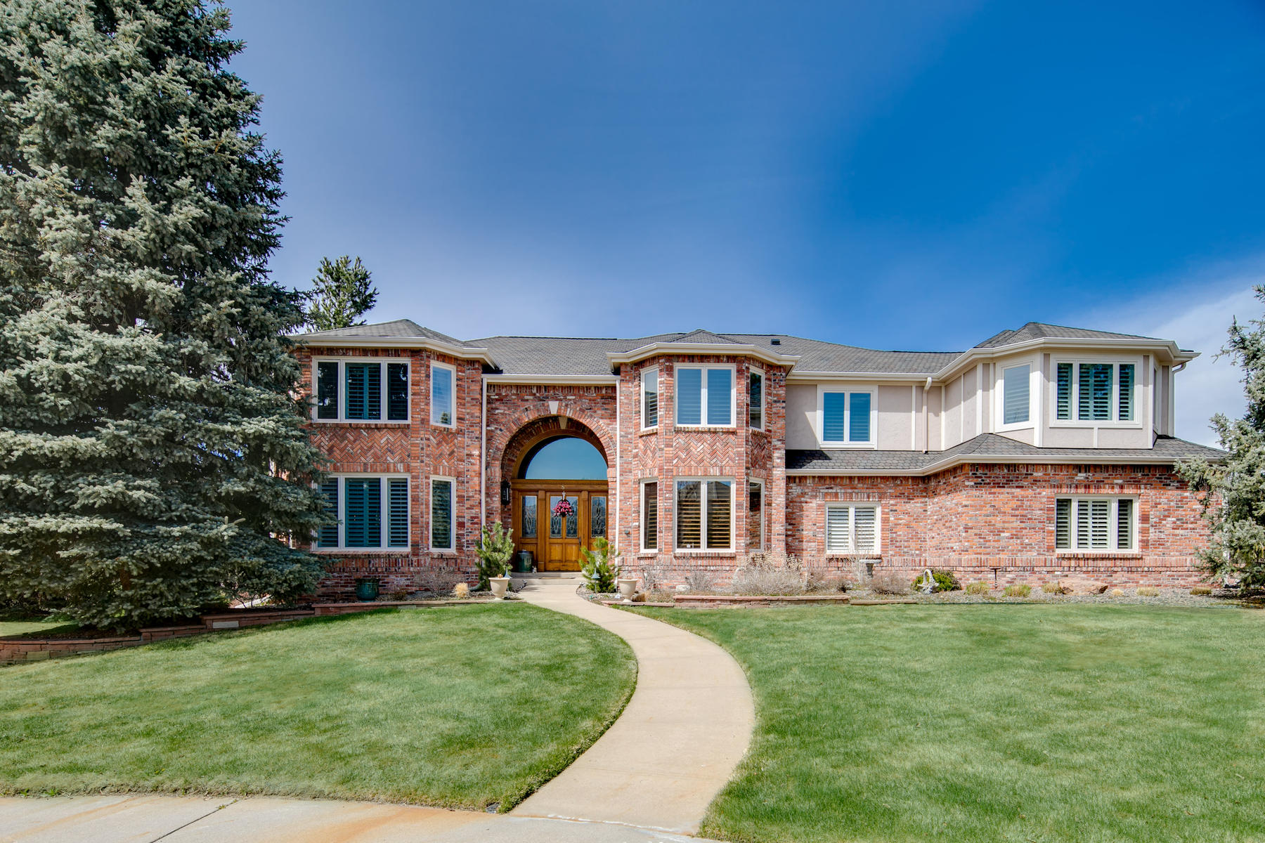 Single Family Home for Active at Gracefully poised a .47 acre cul-de-sac site showcasing majestic mountain views! 8 Red Tail Dr Highlands Ranch, Colorado 80126 United States