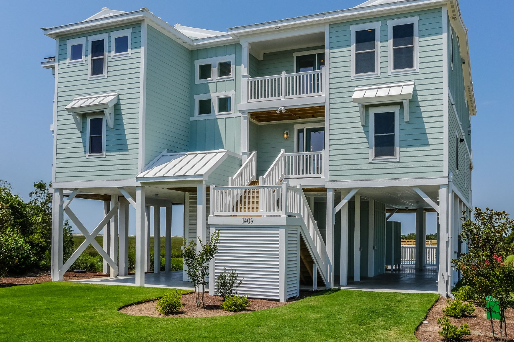 Single Family Home for Sale at Escape to the Oasis of Serenity 1409 Sunset Lane Sunset Beach, North Carolina 28468 United States