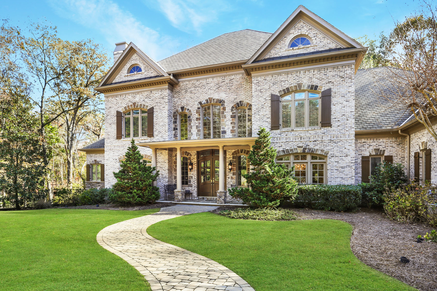 Single Family Homes for Sale at Exceptional Brick And Stone Estate Home In Country Club Of The South 1000 Downing Street Johns Creek, Georgia 30022 United States