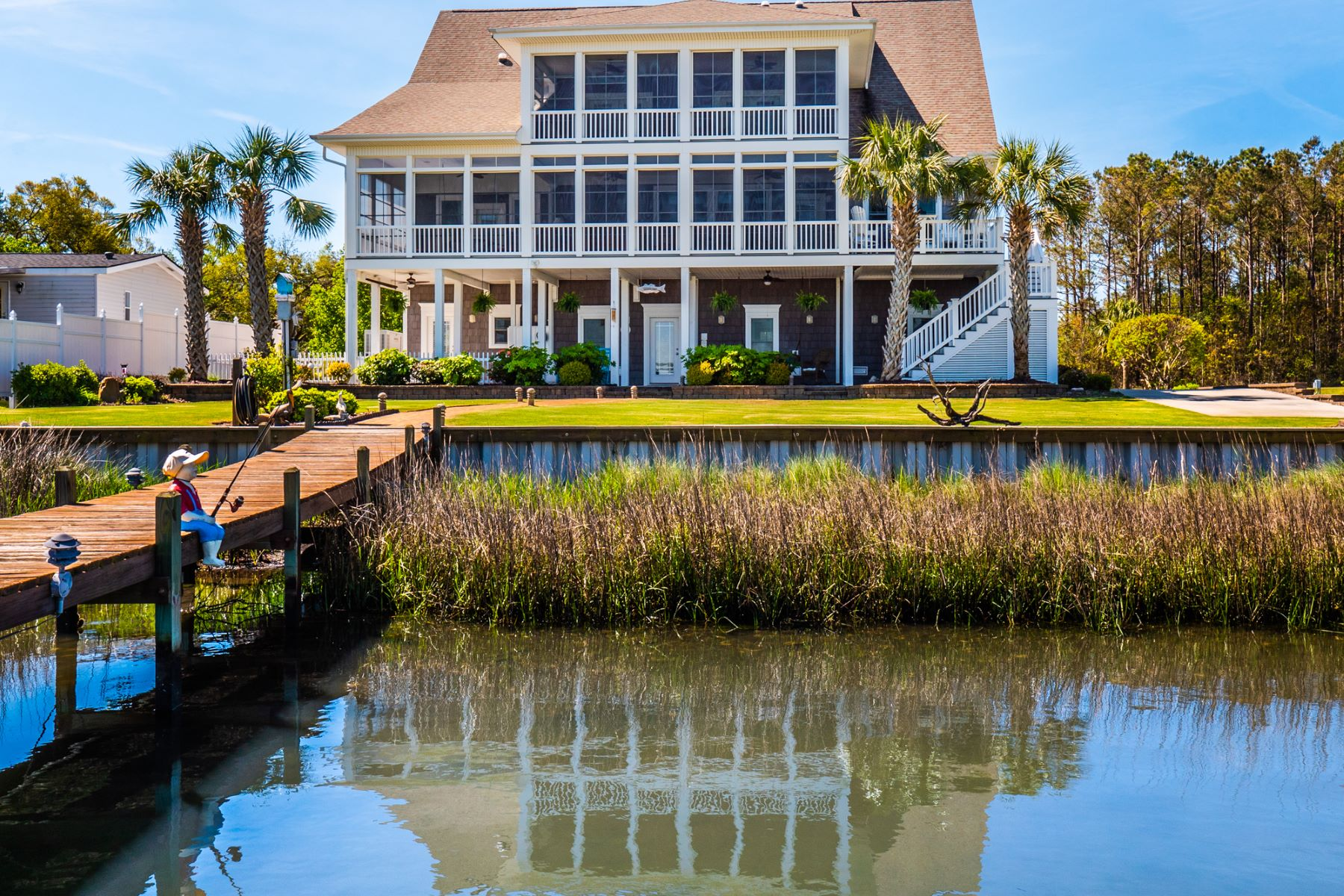 Single Family Homes for Sale at Refined Waterfront Oasis in Sneads Ferry 383 Beacon Lane Sneads Ferry, North Carolina 28460 United States