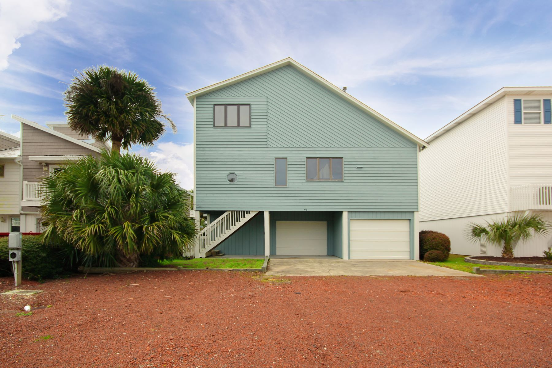Single Family Homes for Sale at Airy, Bright, and Inviting! 43 Pender Street Ocean Isle Beach, North Carolina 28469 United States