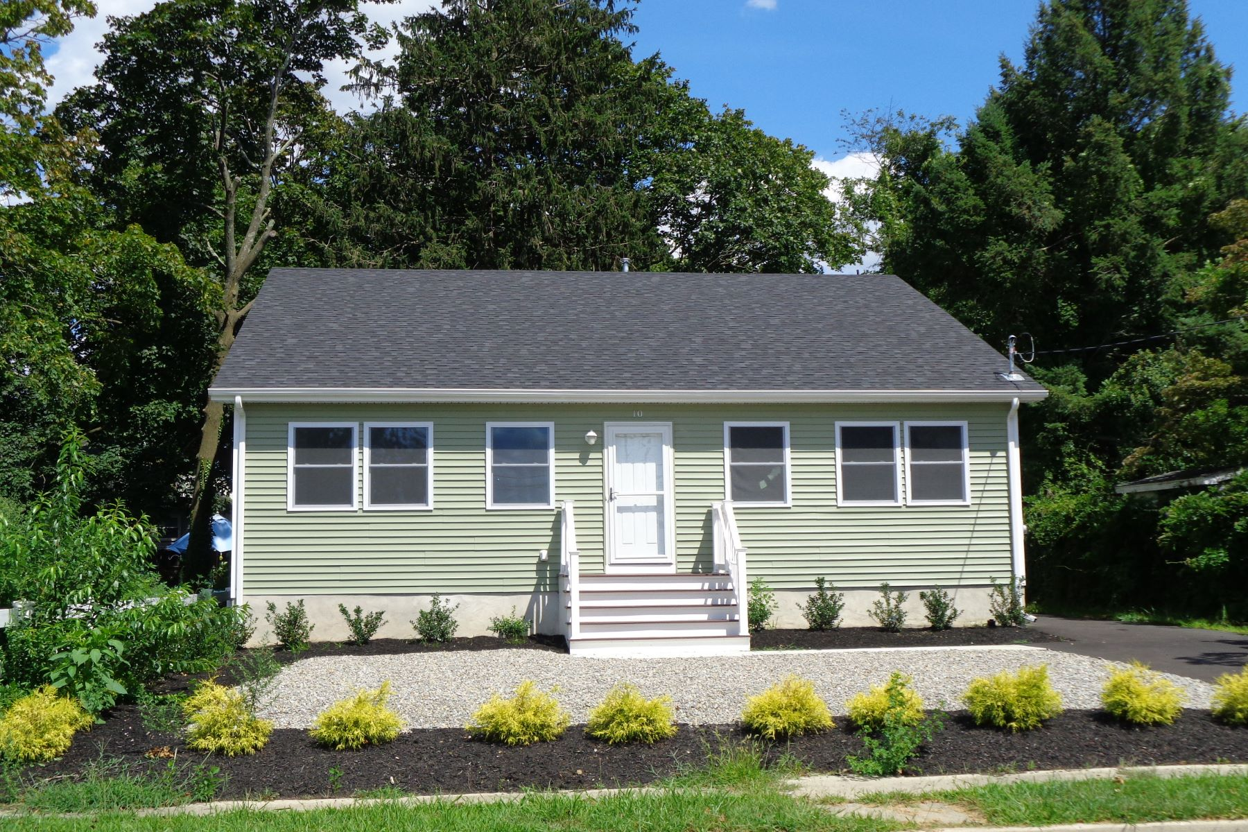 Single Family Homes for Sale at Recently Remodeled With Lots Of Natural Light 10 S Gateway Toms River, New Jersey 08757 United States