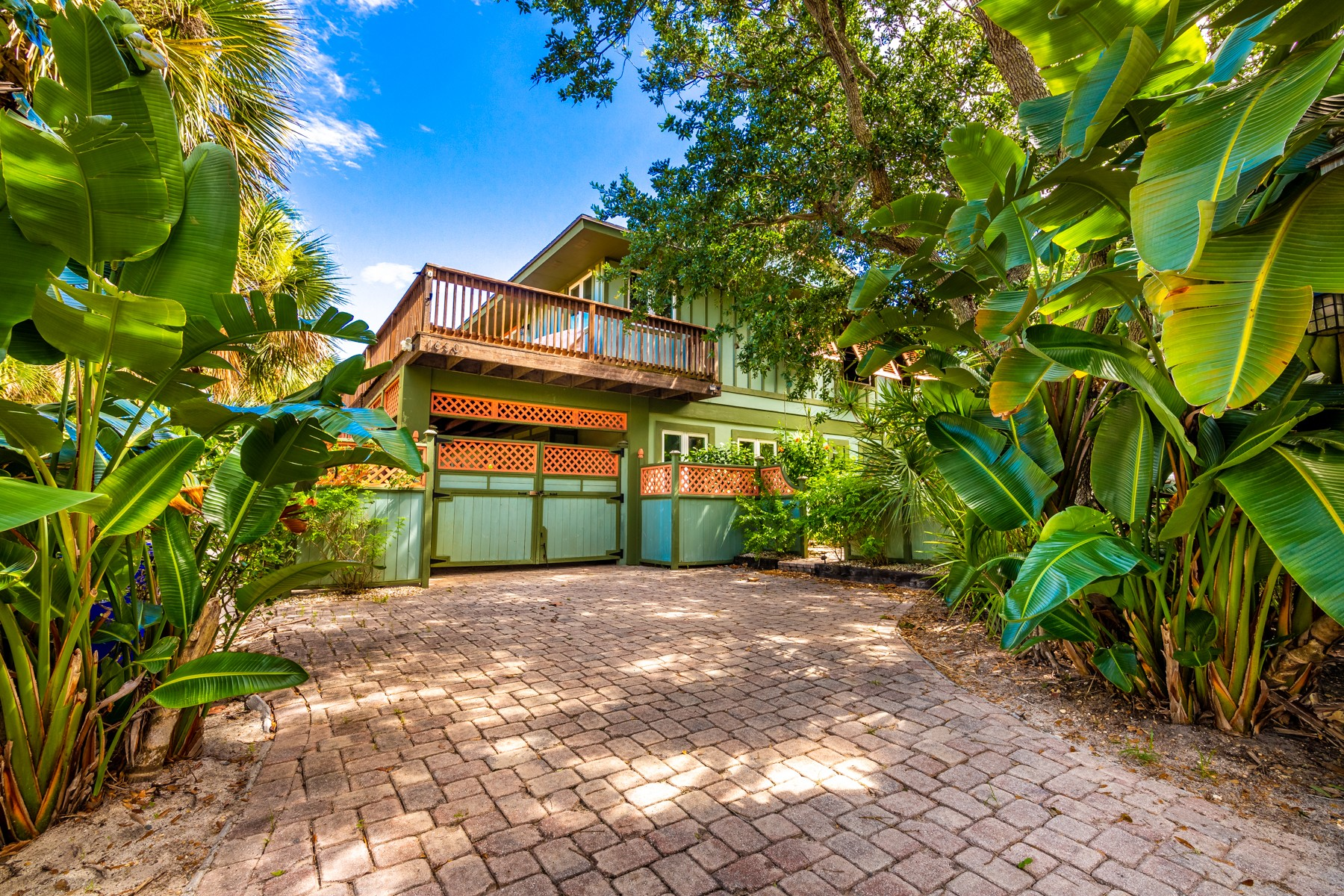 Single Family Homes for Sale at Tropical Home in Tranquil and Quiet Setting 1830 E Cayman Road Vero Beach, Florida 32963 United States