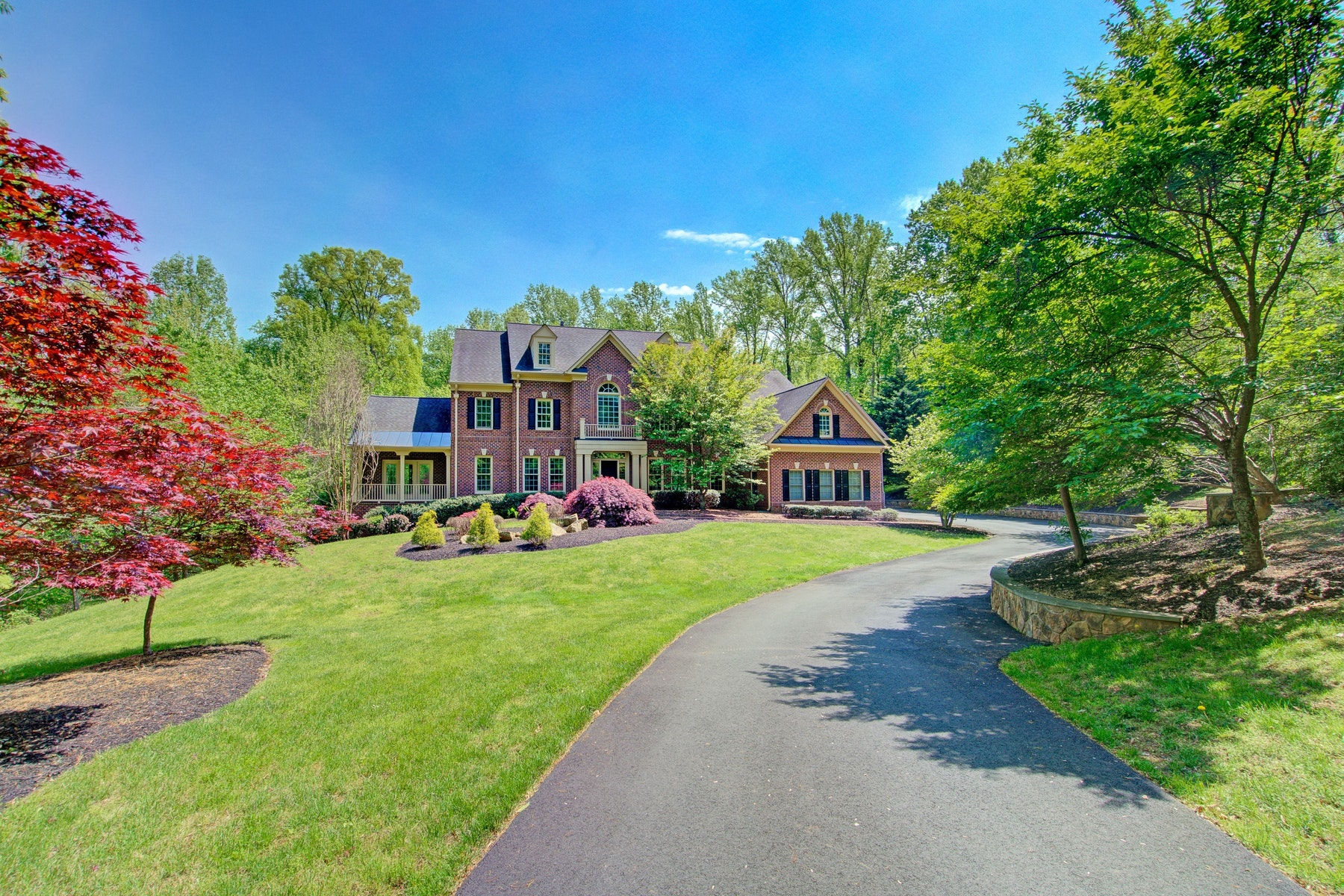 Single Family Homes pour l Vente à Stately Brick Grand Monet 16886 Bold Venture Drive Leesburg, Virginia 20176 États-Unis
