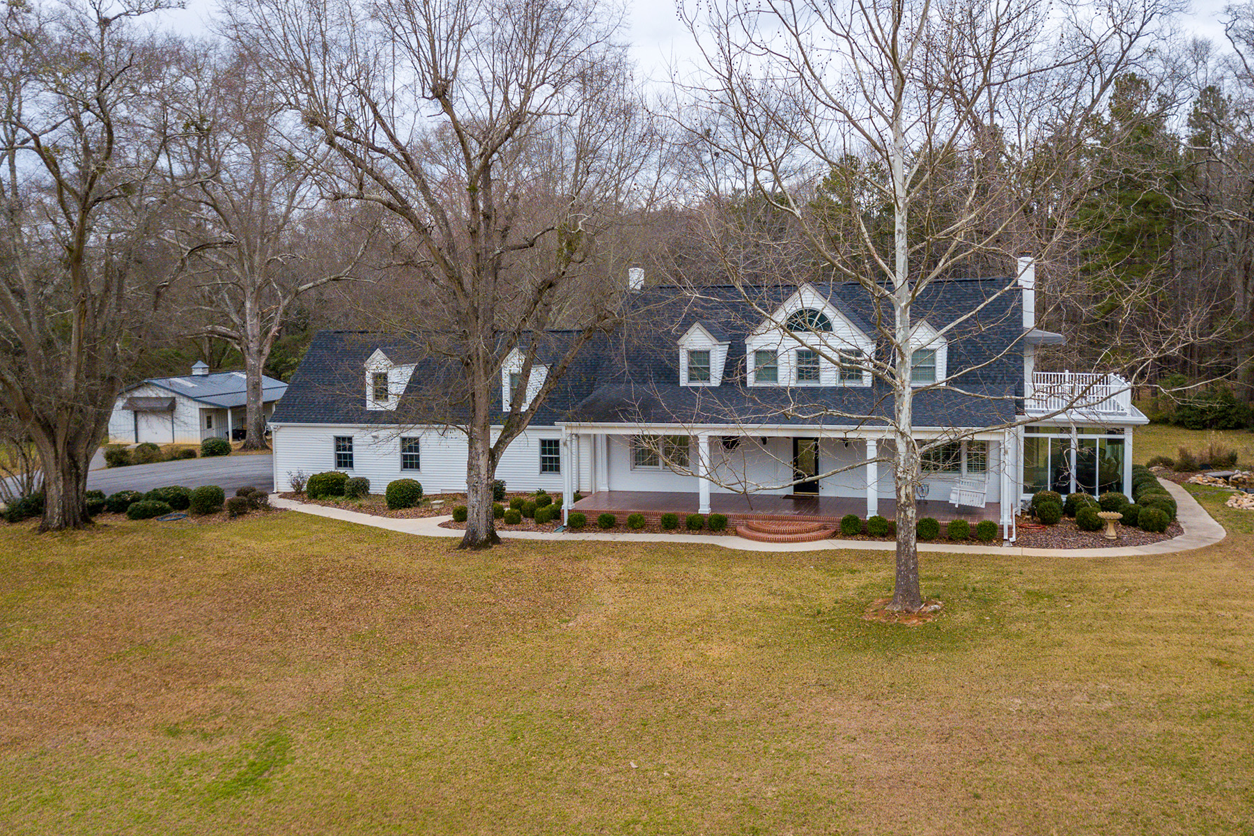 Single Family Homes for Sale at Oozing with Charm, This Inviting Southern-Style Home Rests On 5.44+/- Acres 345 West Johnston Street Forsyth, Georgia 31029 United States