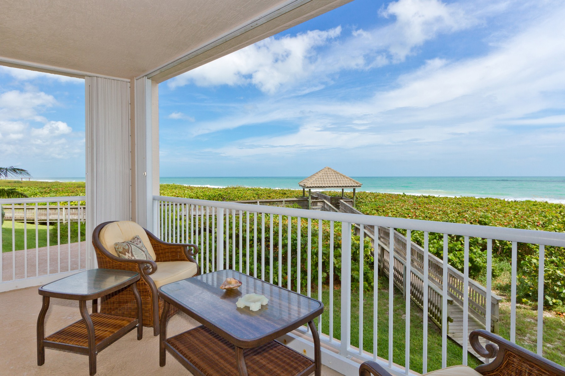 Breathe in Sweeping Turquoise Ocean Views from the Wrap-Around Balcony 4160 N Highway A1A #201A Hutchinson Island, Florida 34949 Usa
