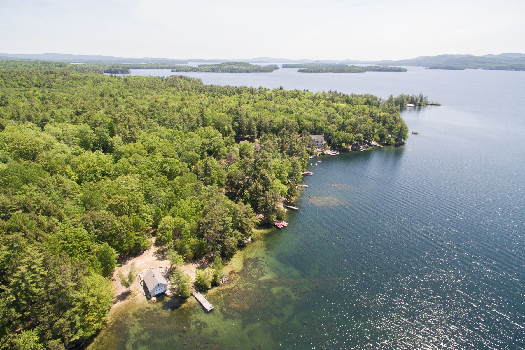 Single Family Homes por un Venta en 55 Acre Lake Winnipesaukee Estate in Meredith 47 Happy Homes Rd Meredith, Nueva Hampshire 03253 Estados Unidos
