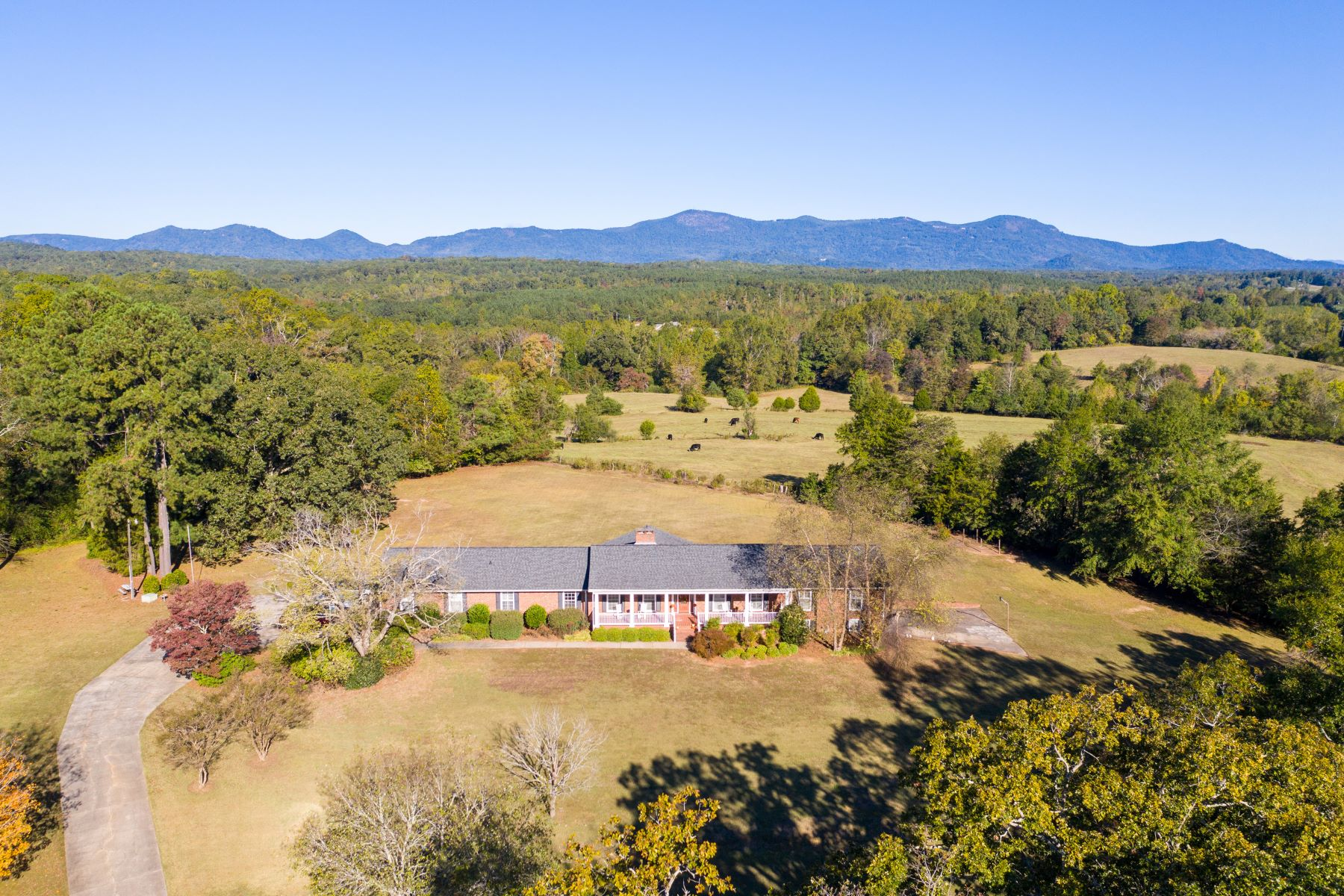 Single Family Homes for Active at Updated home on 5+ acres with breathtaking mountain views! 611 E Prince Road Landrum, South Carolina 29356 United States
