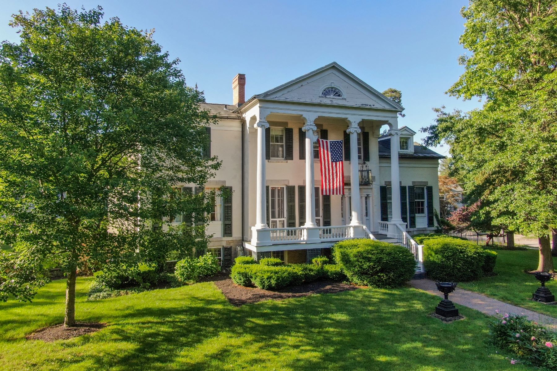 Single Family Homes for Sale at Greek Revival in Skaneateles Village 62 West Genesee Street Skaneateles, New York 13152 United States