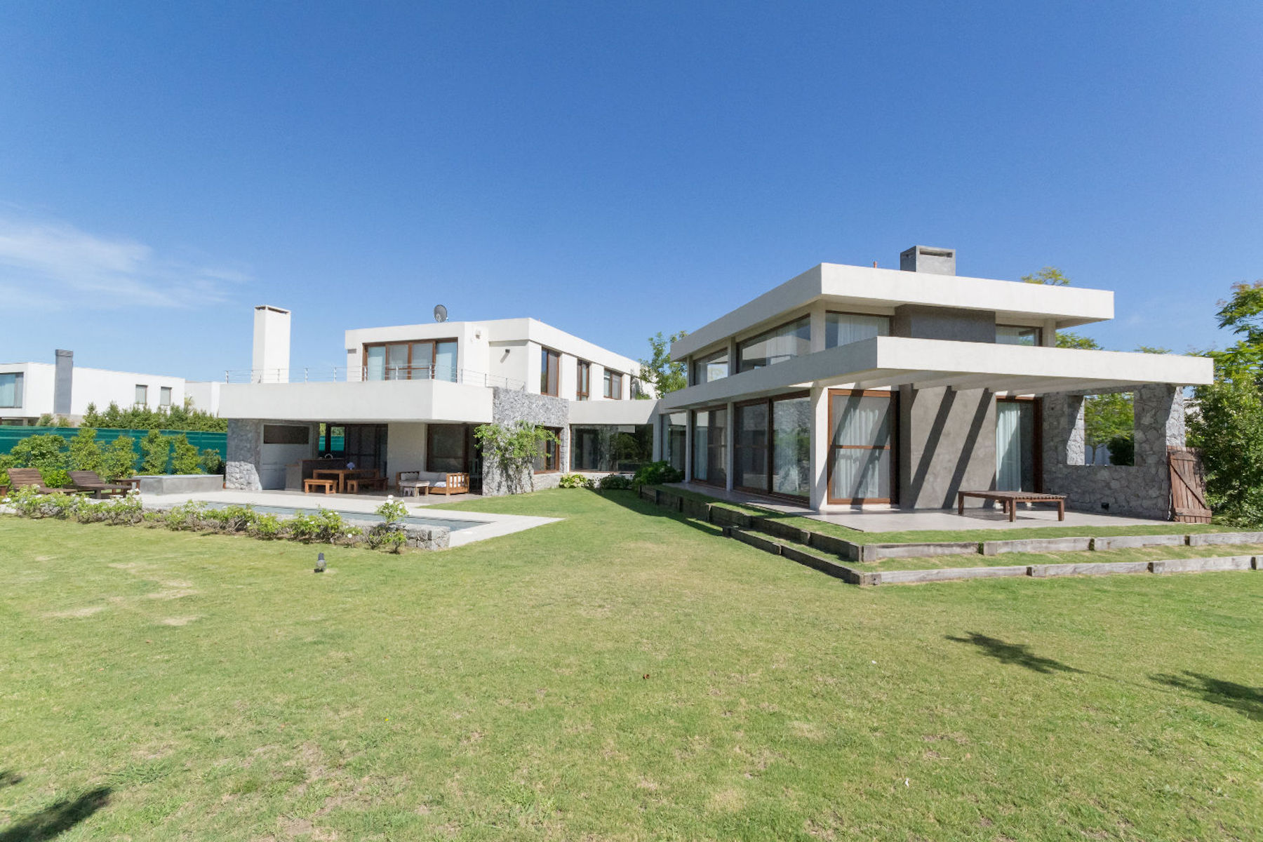 Single Family Home for Sale at Modern residence with green golf view in Nordelta Av. del Golf 100 Barrio el Golf Other Buenos Aires, Buenos Aires 1670 Argentina