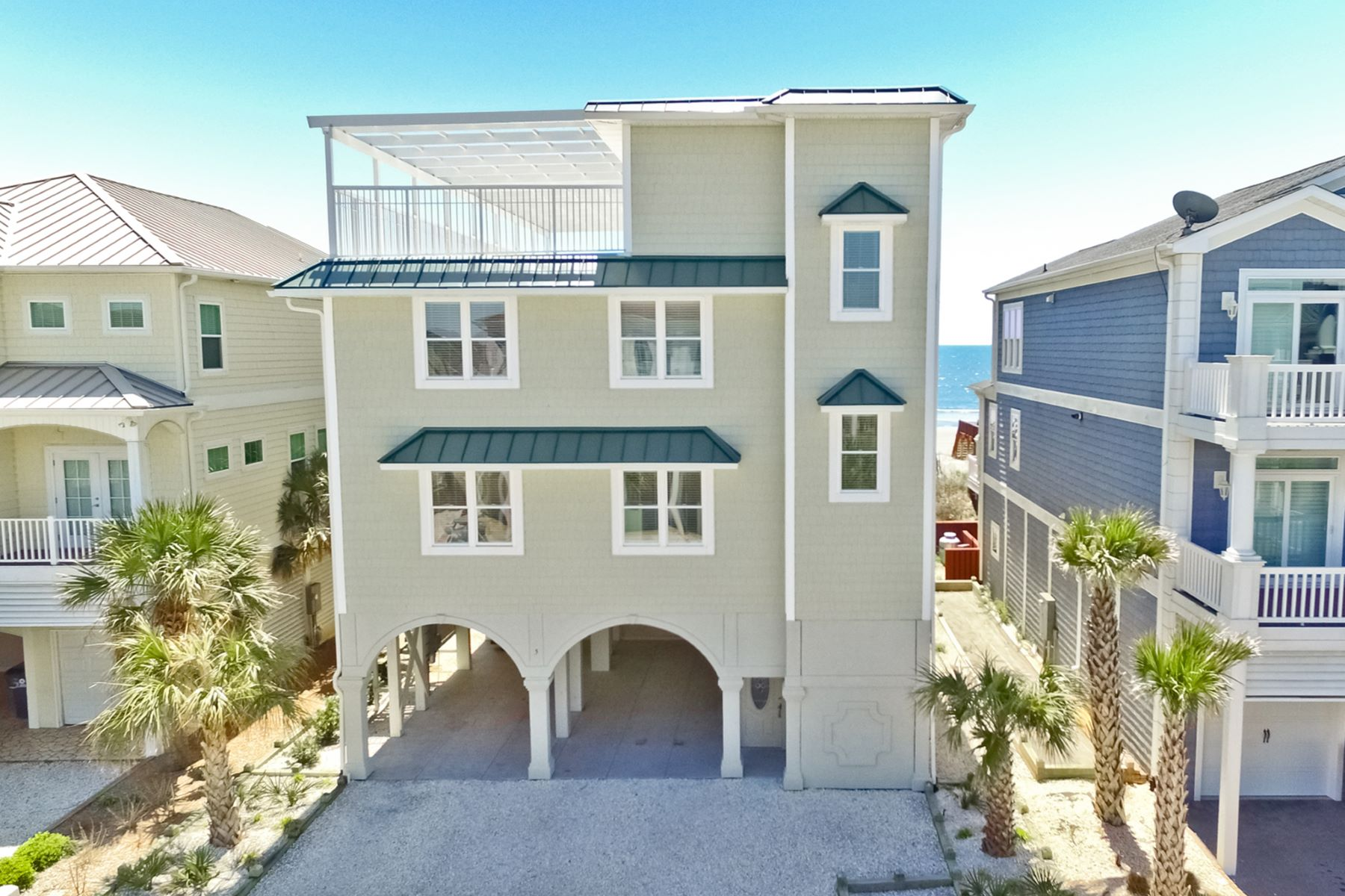 Single Family Homes for Active at Oceanfront Oasis with Rooftop Deck 5 Coggeshall Drive Ocean Isle Beach, North Carolina 28469 United States
