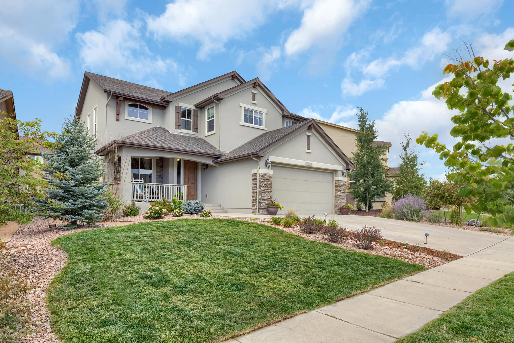 Single Family Home for Active at Spacious sunshine and a fantastic flow awaits 9180 Lizard Rock Trl Colorado Springs, Colorado 80924 United States