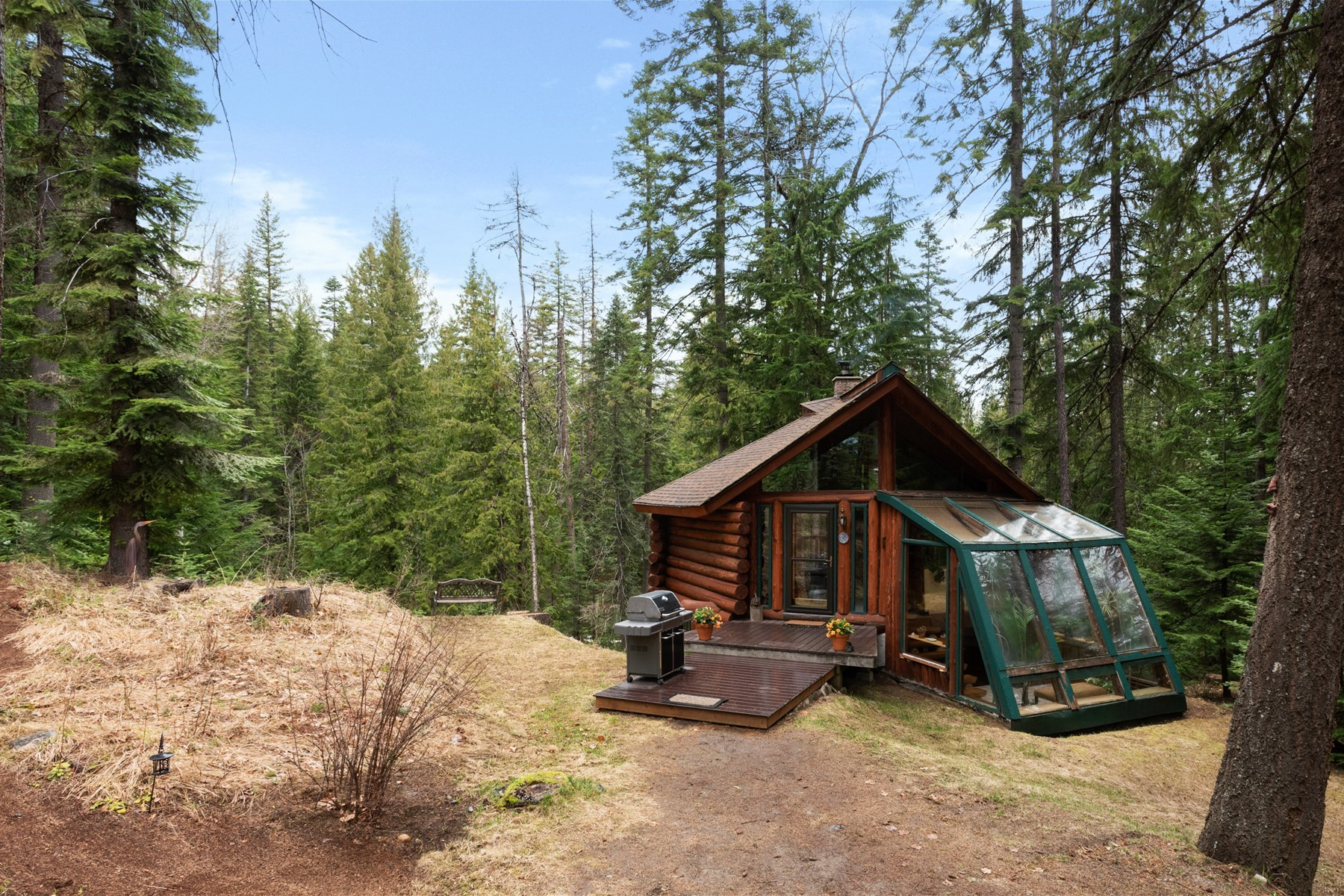 Single Family Home for Active at Delightful Log Cabin Overlooking Creek 2353 Roop Road Cocolalla, Idaho 83813 United States