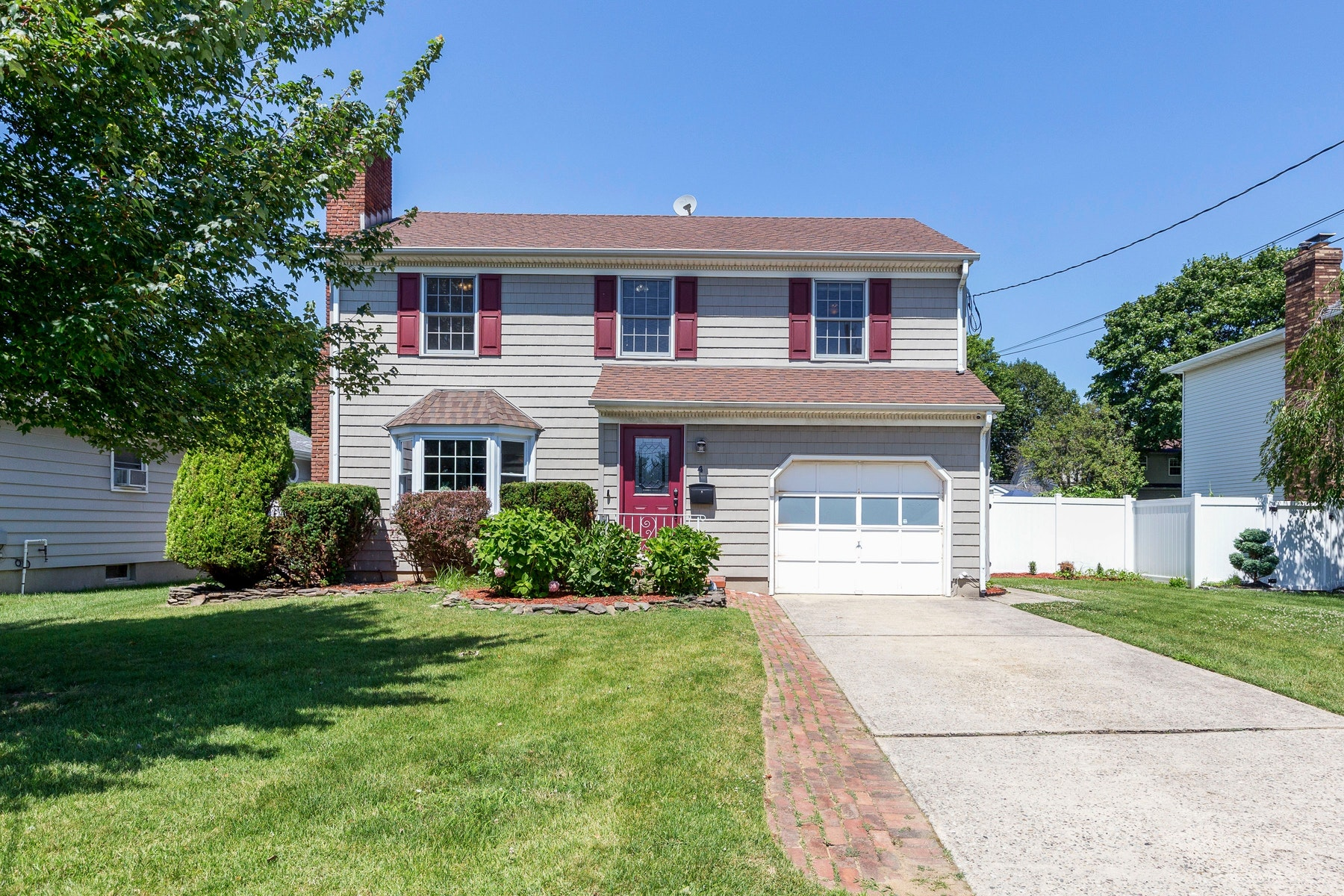 Single Family Homes for Sale at Colonial Style with Modern Amenities 4 Charles Street Sayreville, New Jersey 08879 United States