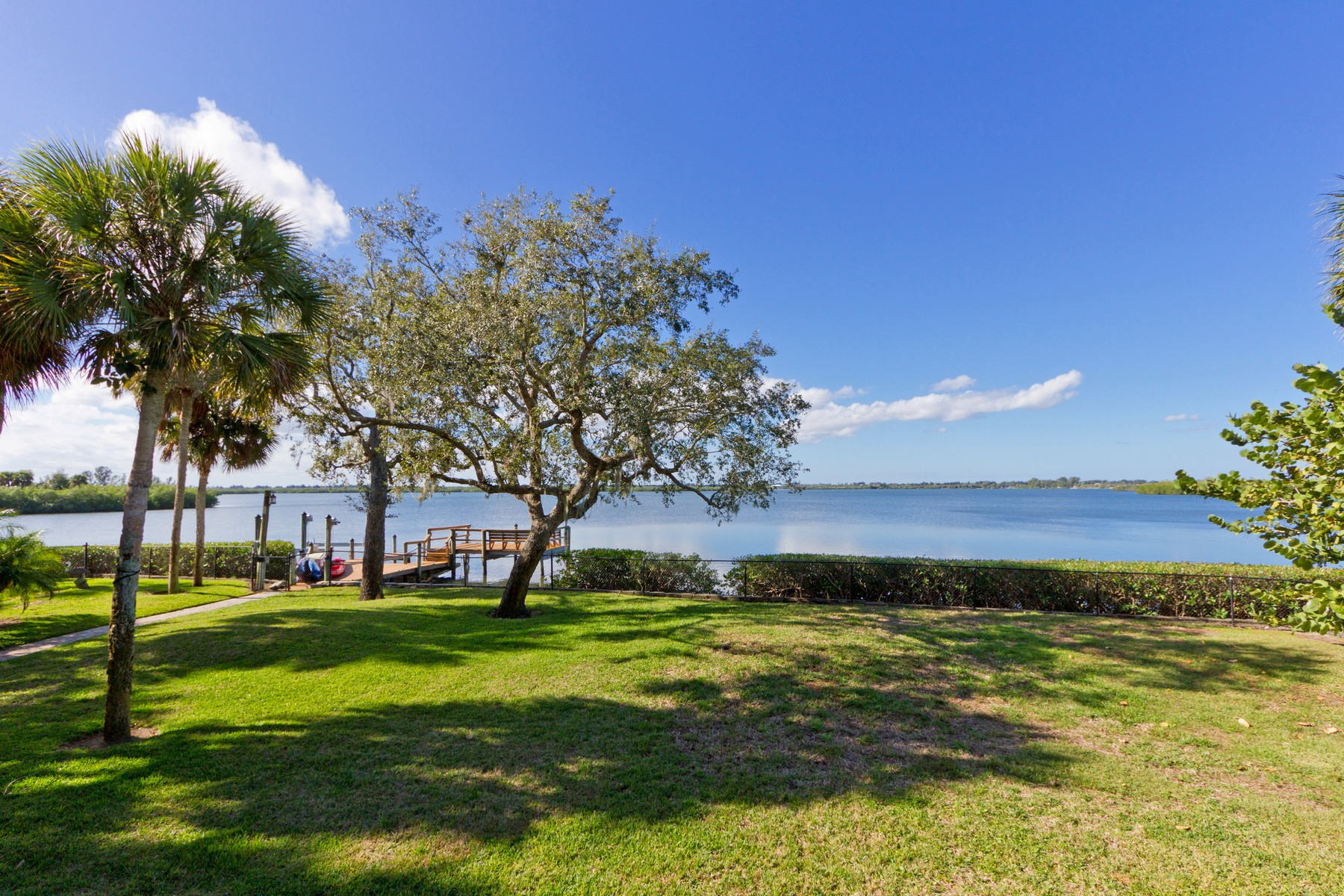 Single Family Home for Sale at Breathe in Endless Views of Playful Dolphin, Vivid Sunsets and Peaceful Kayakers 335 Cathedral Oaks Dr Vero Beach, Florida 32963 United States