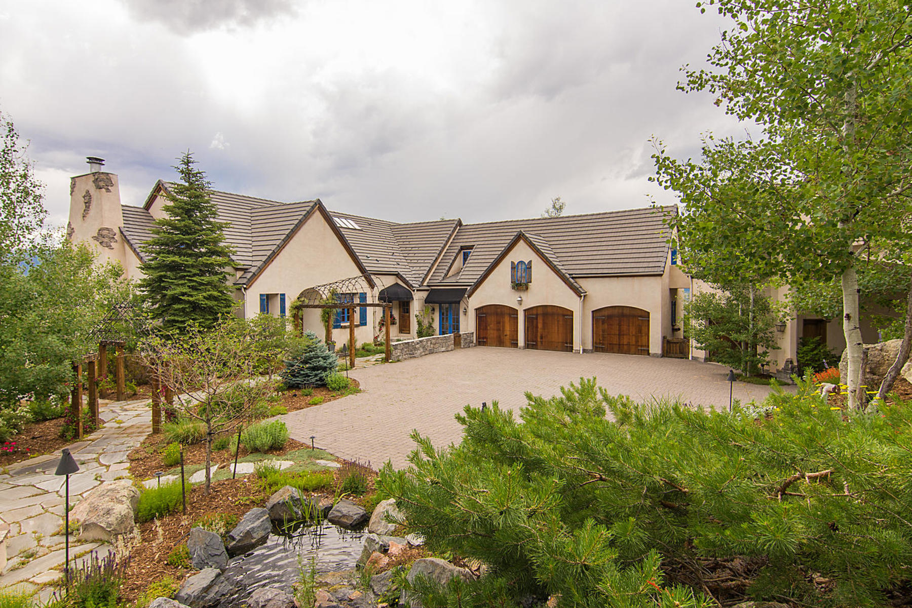 Single Family Homes for Sale at Custom Masterpiece perched right onto the side of Dawson Butte. 5074 S Perry Park Rd Sedalia, Colorado 80135 United States