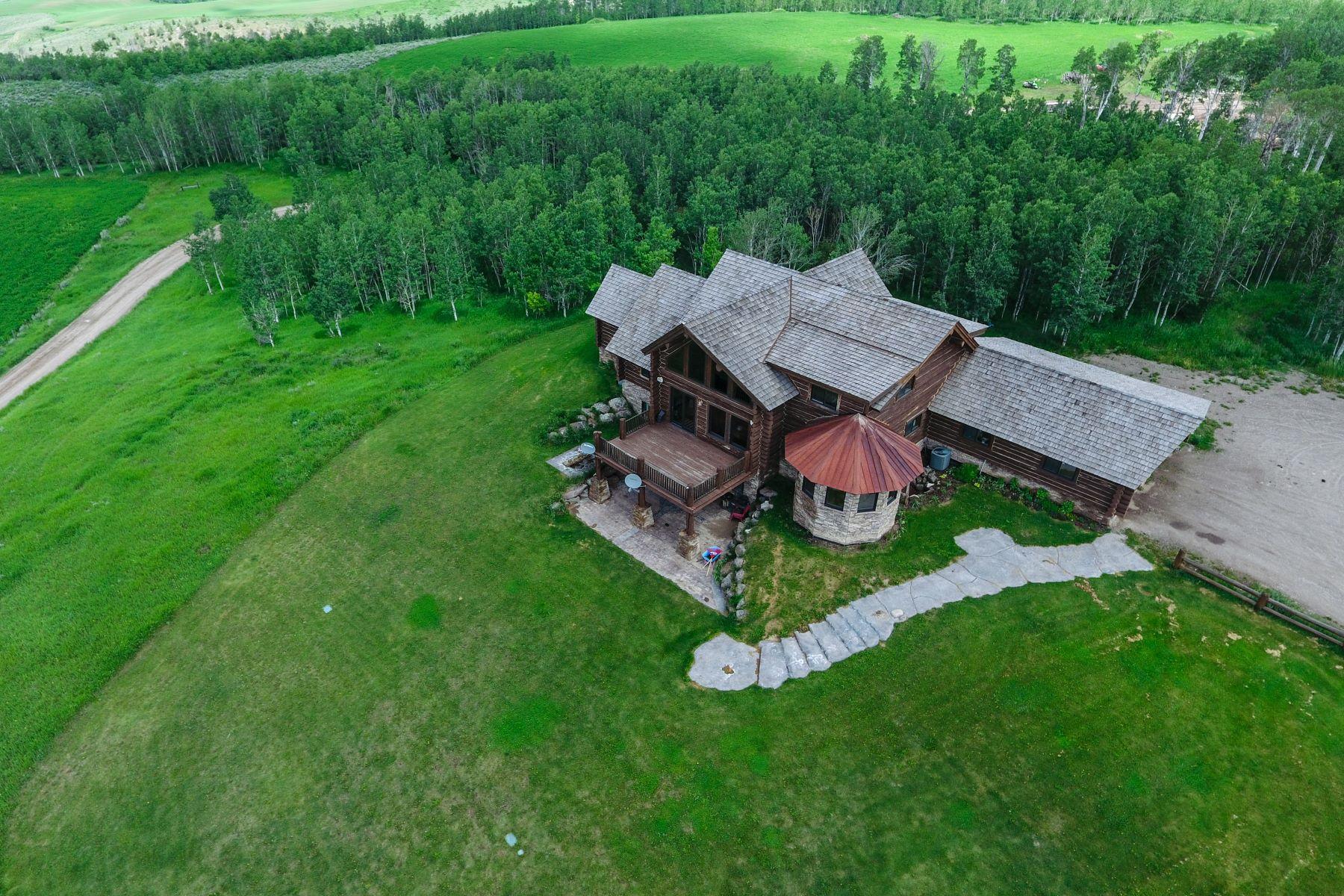 Maison unifamiliale pour l Vente à Custom Built Log Home on 120 Acres 700 N 4775 E Ashton, Idaho 83420 États-Unis