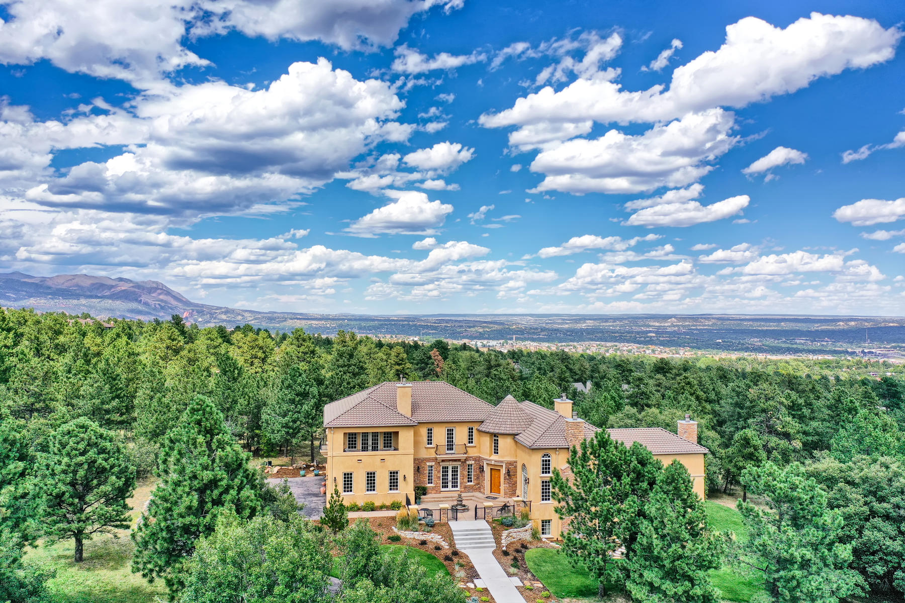 Single Family Homes for Sale at Nestled on 1.52 acres in the prestigious gated community of Stratton Preserve 1970 Fox Mountain Pt Colorado Springs, Colorado 80906 United States