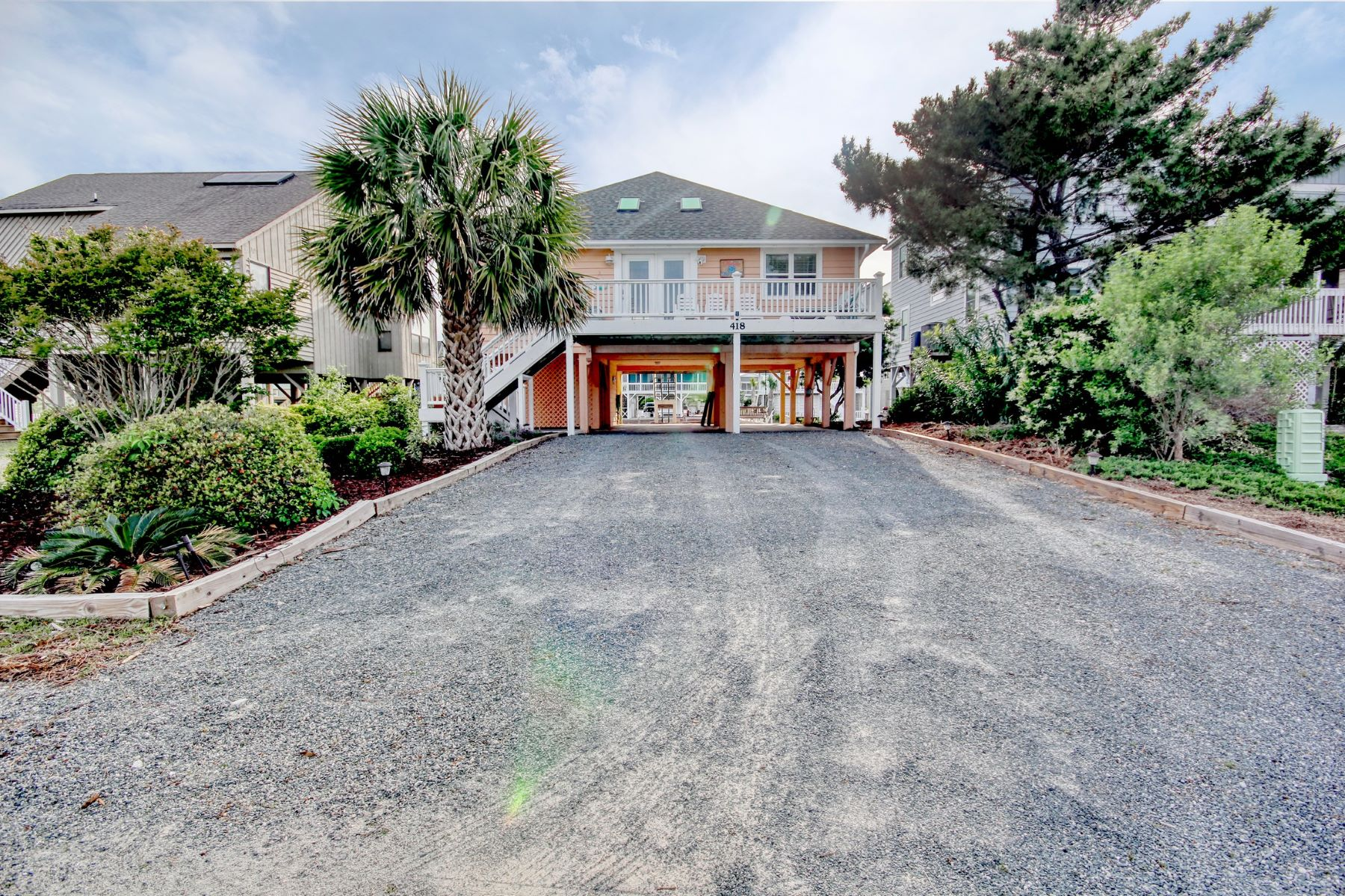 Single Family Homes for Sale at Canal Front Home in Sunset Beach 418 Sailfish St Sunset Beach, North Carolina 28468 United States