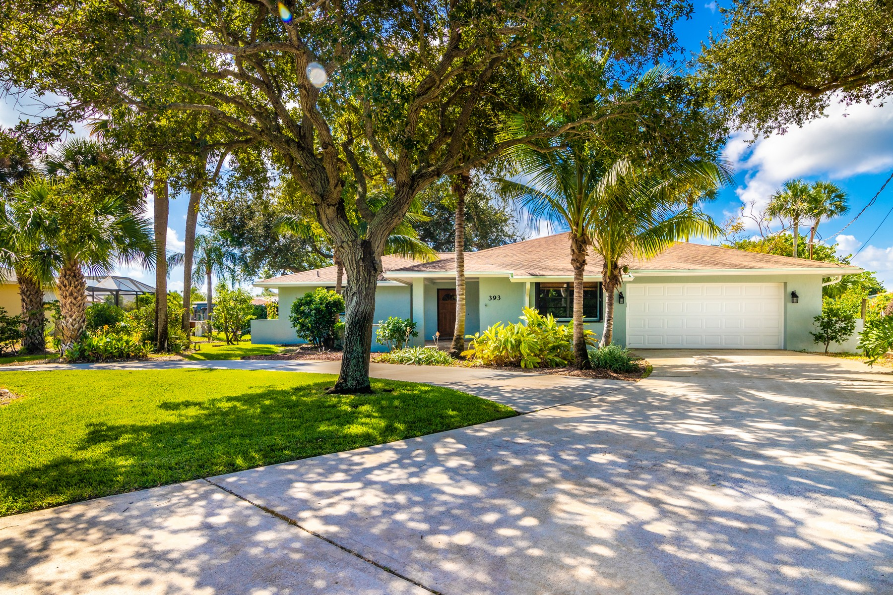 Single Family Homes for Sale at Charming Canal Front Home with Airy, Open Layout 393 Nikomas Way Melbourne Beach, Florida 32951 United States