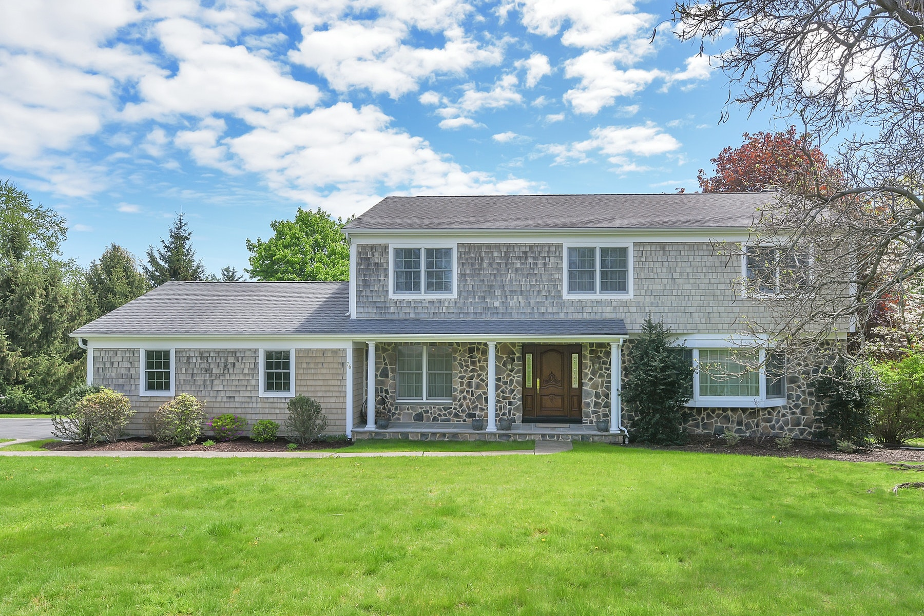 Single Family Homes for Sale at Picture Perfect Center Hall Colonial! 76 Carlough Road Upper Saddle River, New Jersey 07458 United States
