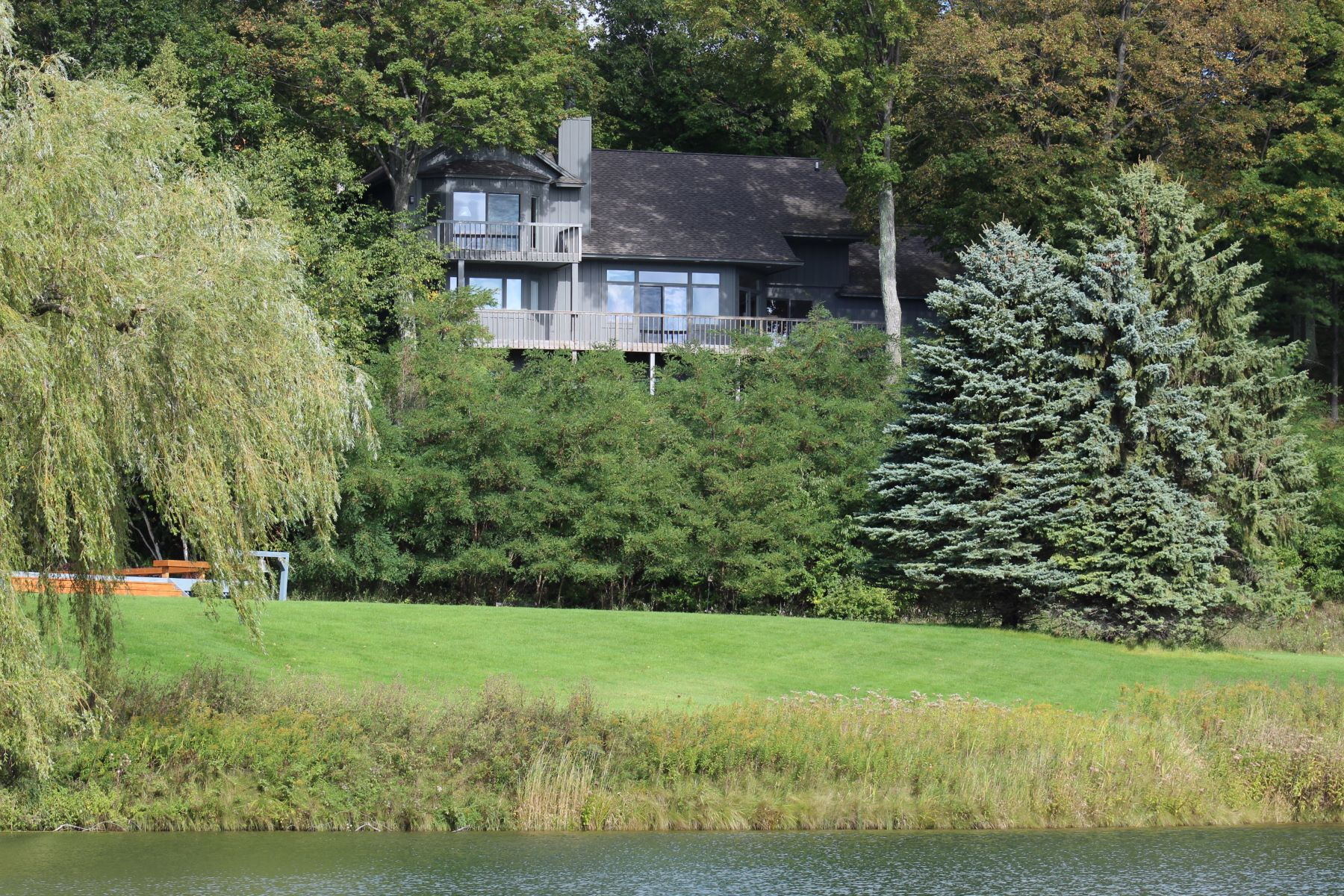 Single Family Homes for Active at Extraordinary home with panoramic Lake Michigan views 1038 Timber Pass Harbor Springs, Michigan 49720 United States