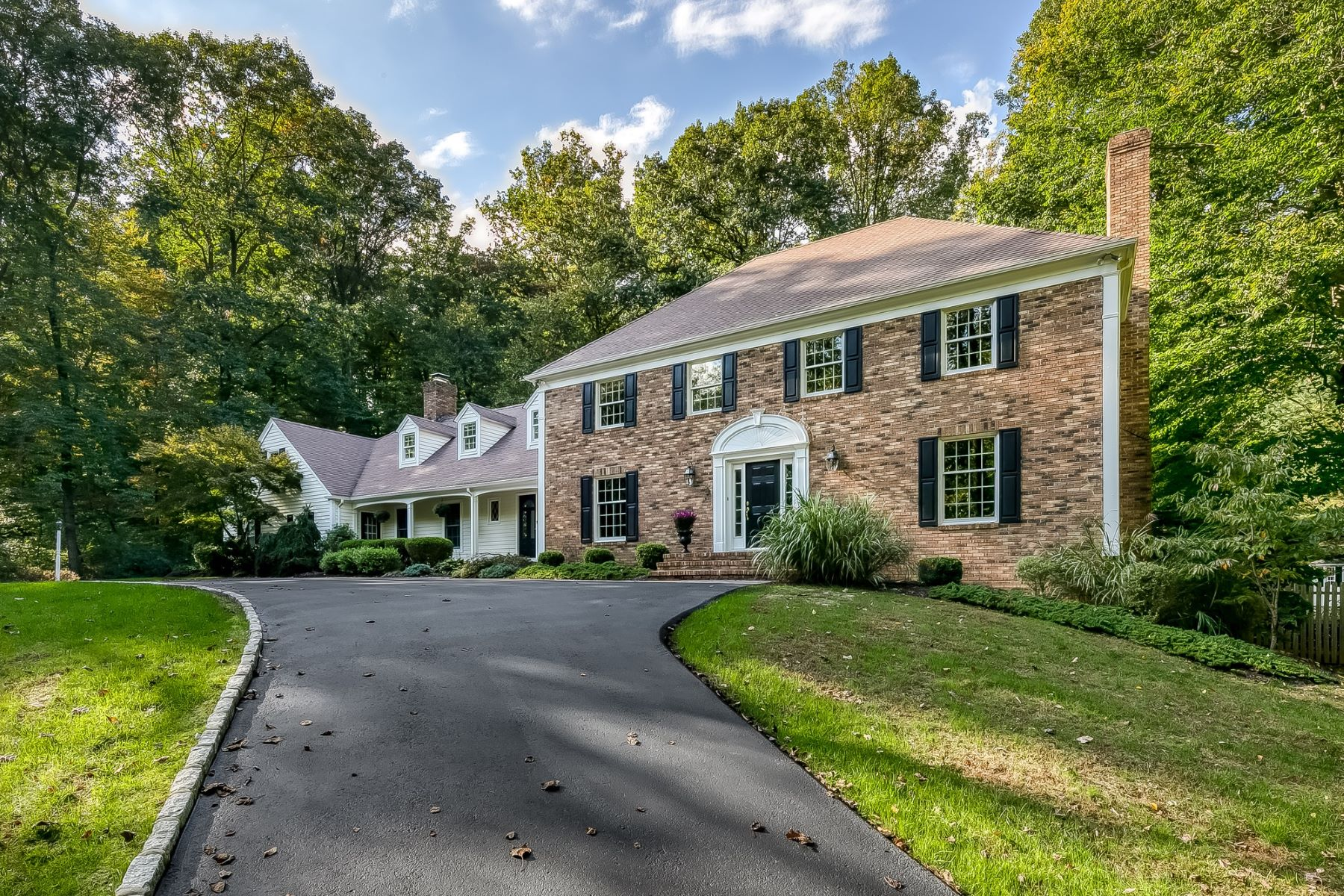 Single Family Homes for Sale at Stunning Center Hall Colonial 6 Indian Hollow Road Mendham, New Jersey 07945 United States