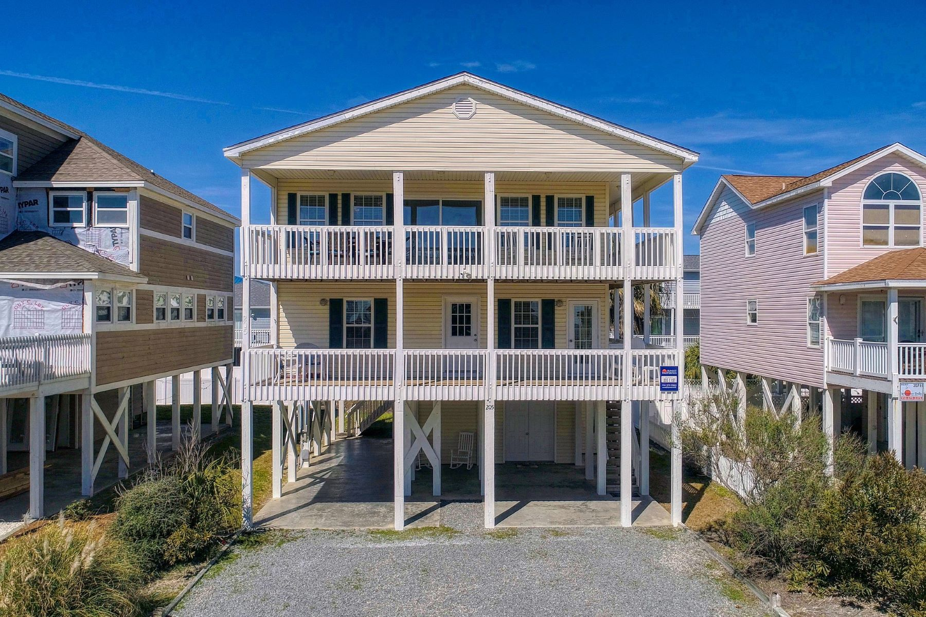 Single Family Homes for Sale at Second Row Beach House with Ocean View 205 E First Street Ocean Isle Beach, North Carolina 28469 United States