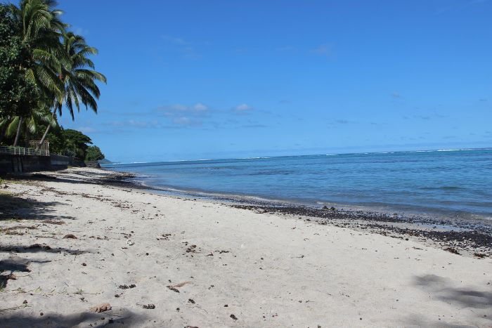 Facing Moorea on a white sand beach