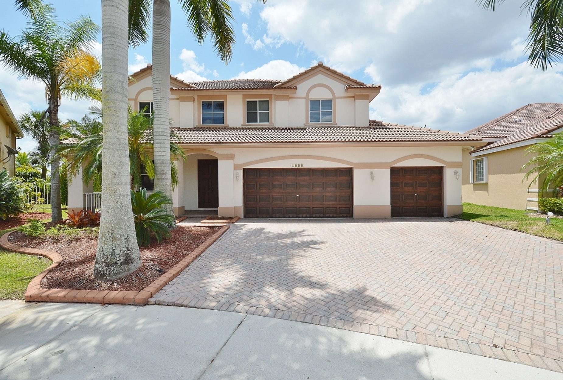 Casa Unifamiliar por un Venta en 1538 Cardinal Way Weston, Florida, 33327 Estados Unidos