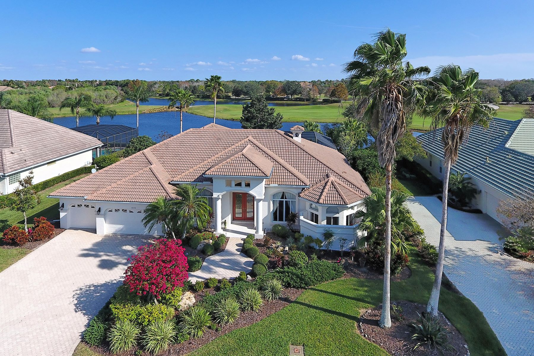 Casa Unifamiliar por un Venta en LAKEWOOD RANCH COUNTRY CLUB 8040 Royal Birkdale Cir Lakewood Ranch, Florida, 34202 Estados Unidos