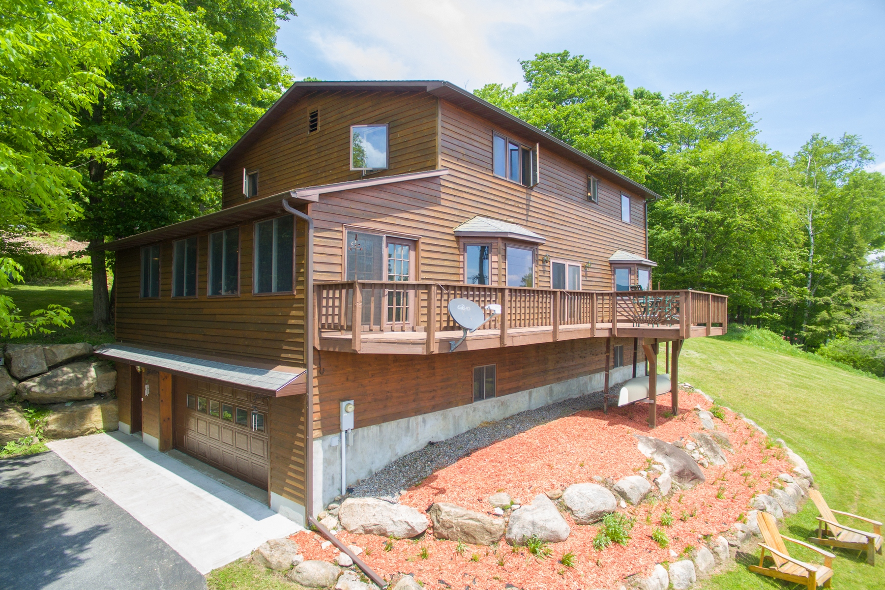 Single Family Home for Sale at Colonial Overlooking the Lake 573 Hollywood Hills Old Forge, New York 13420 United States