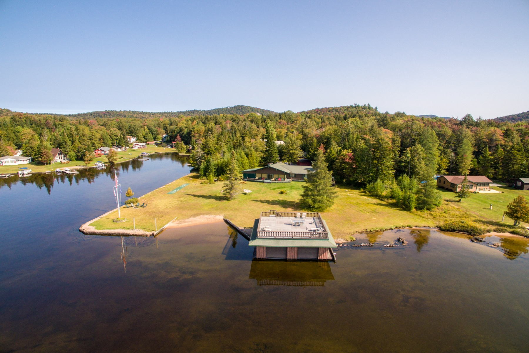 Single Family Home for Sale at Sweeping Waterfront Vistas 188 Eagle Creek Rd. Eagle Bay, New York 13420 United States