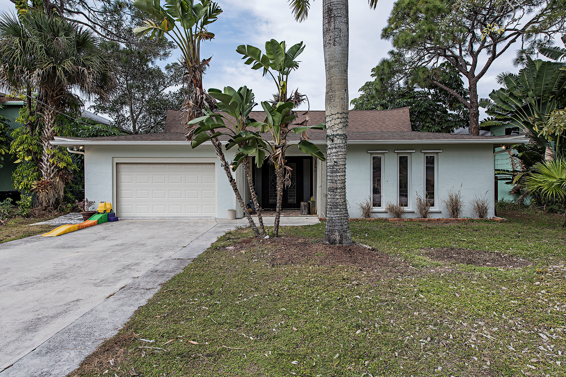 Single Family Home for Sale at PALM RIVER - PALM RIVER SHORES 85 Shores Ave Naples, Florida, 34110 United States