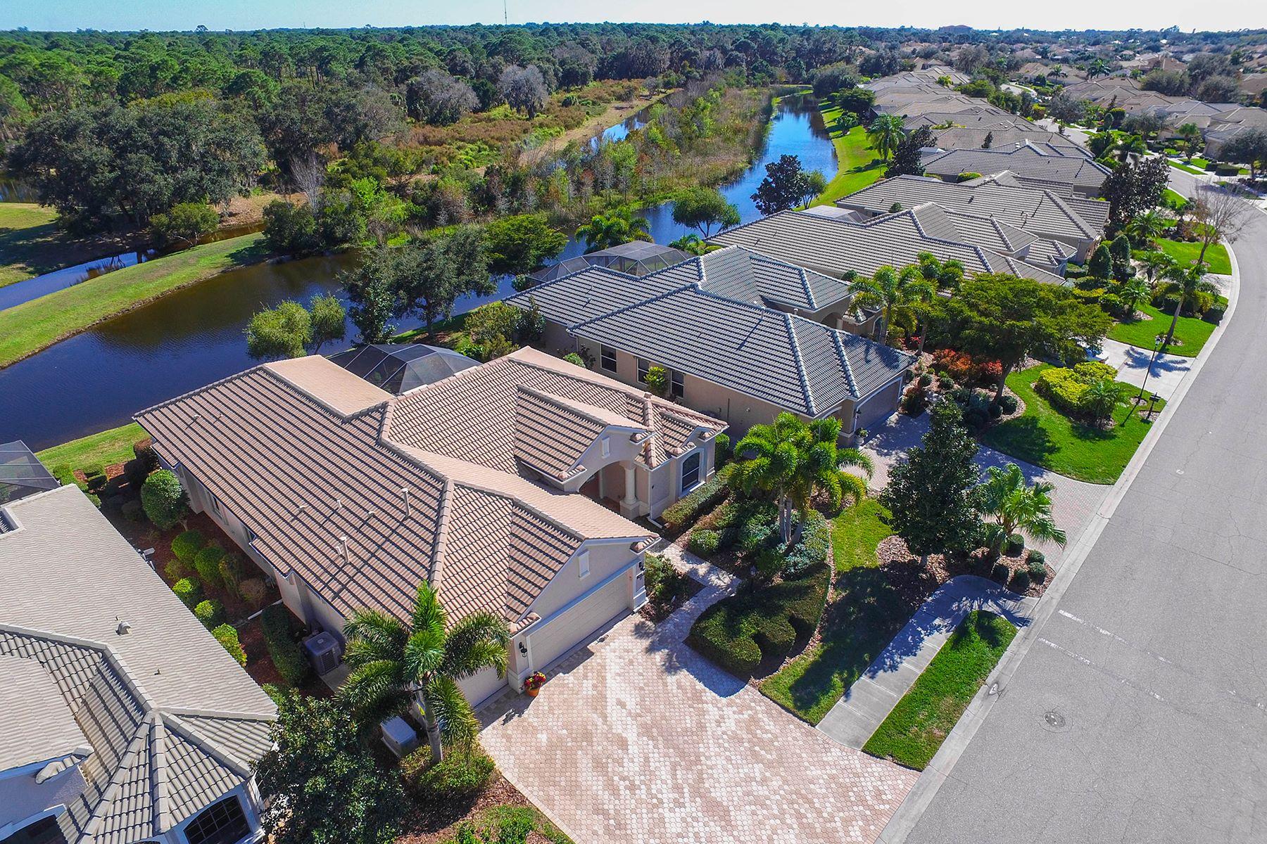 Maison unifamiliale pour l Vente à WILLOWBEND 680 Crane Prairie Way Osprey, Florida, 34229 États-Unis