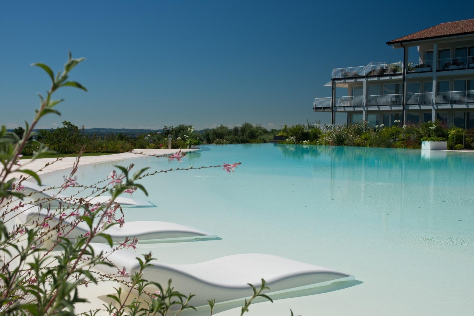 Apartments for Sale at Prestigious apartment with breathtaking view on Lake Garda Padenghe sul Garda, Brescia Italy