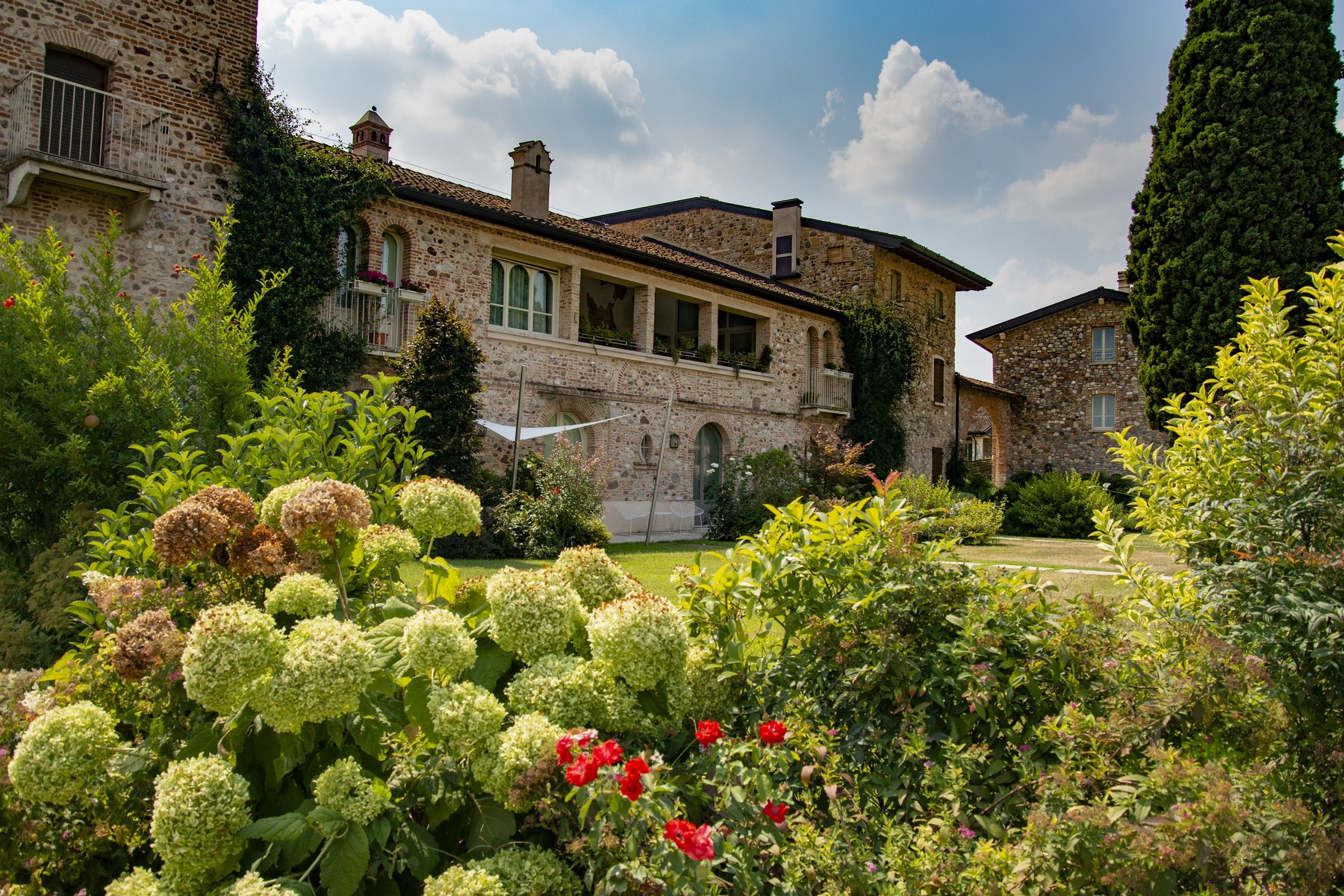 Apartments for Sale at Charming penthouse within the renowned Chervò Golf Desenzano Del Garda, Brescia Italy