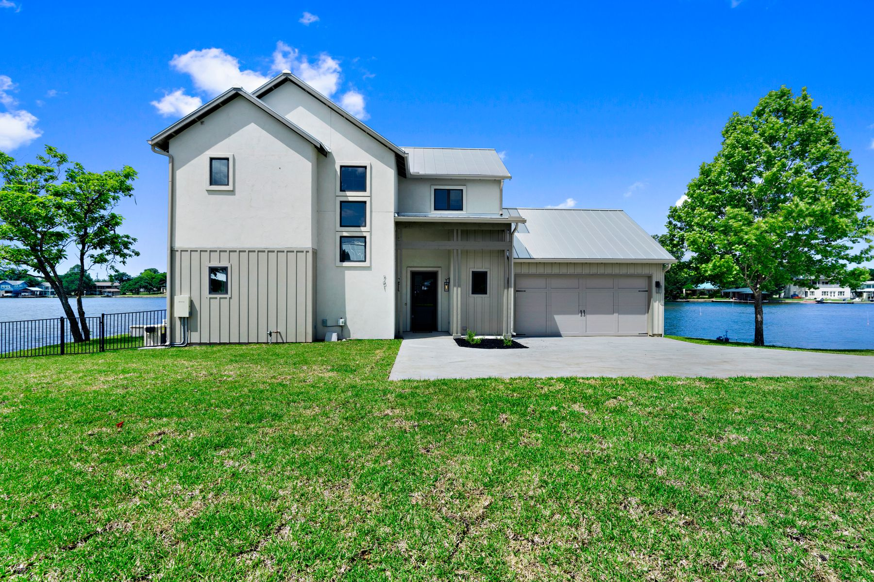 Single Family Homes for Sale at Fantastic Modern Farmhouse /// New Construction on Lake LBJ 701 Woodland Hills Drive On Lake LBJ Marble Falls, Texas 78654 United States