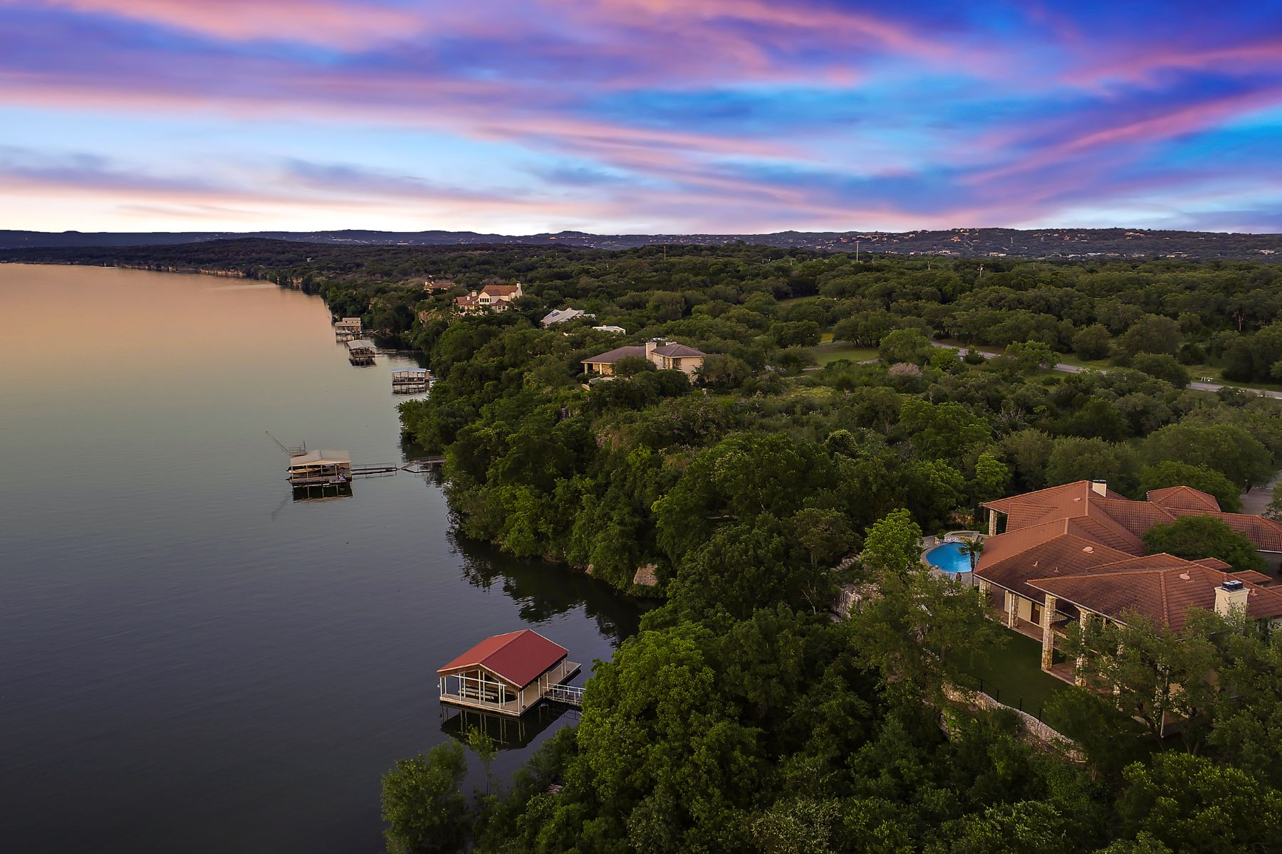 Single Family Homes for Sale at Unique Spanish-Style Waterfront Hacienda 1600 Las Entradas Drive Spicewood Spicewood, Texas 78669 United States