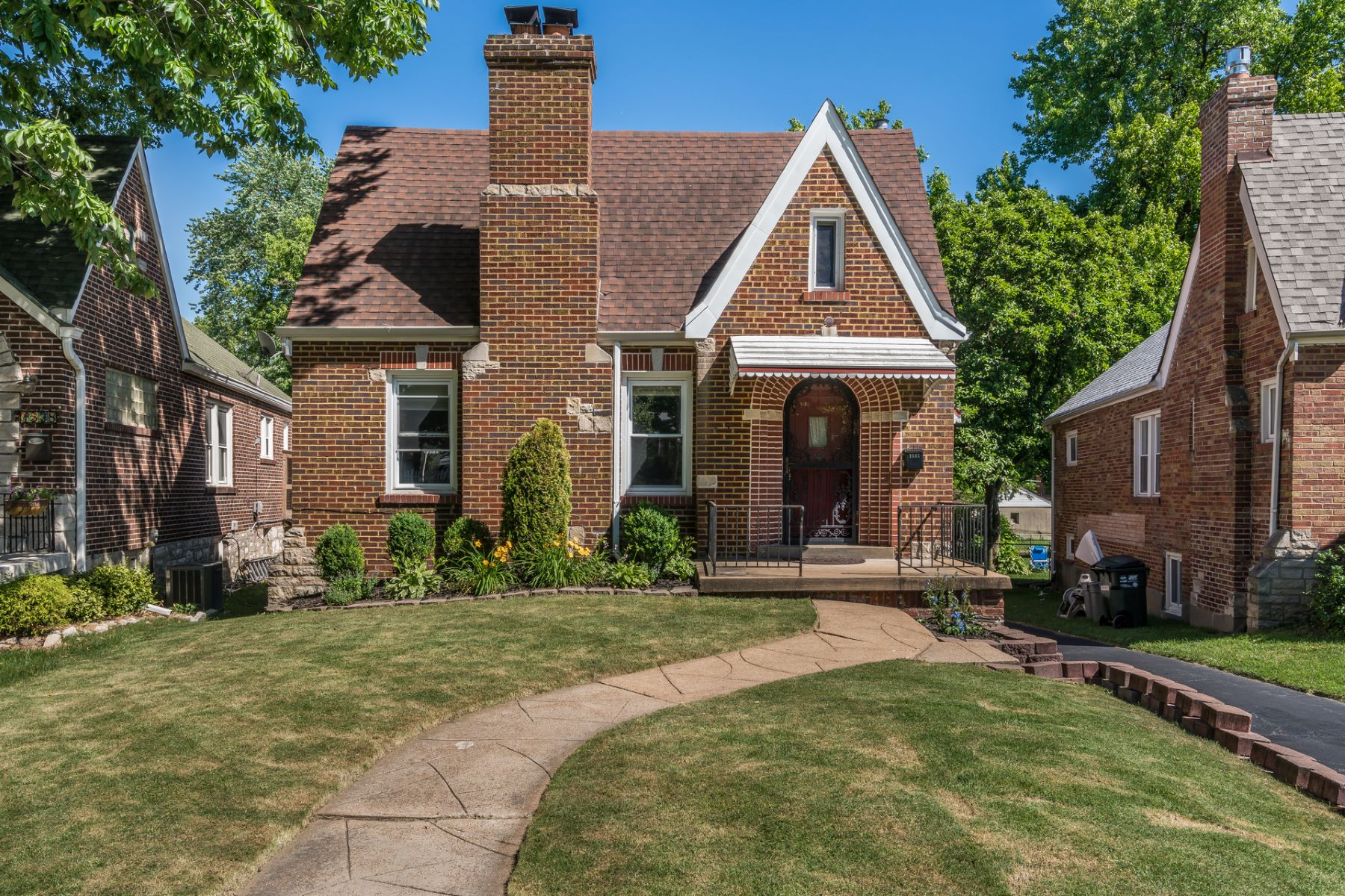 Single Family Homes for Sale at Charming Brick Tudor Home 1542 Collins Avenue Richmond Heights, Missouri 63117 United States
