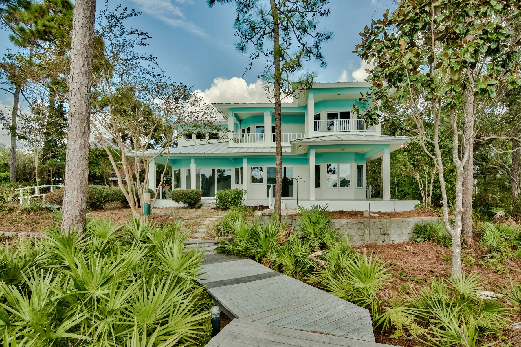 Single Family Homes for Sale at Contemporary Waterfront Home with Private Dock in Bluewater Bay 4396 Windlake Drive, Niceville, Florida 32578 United States