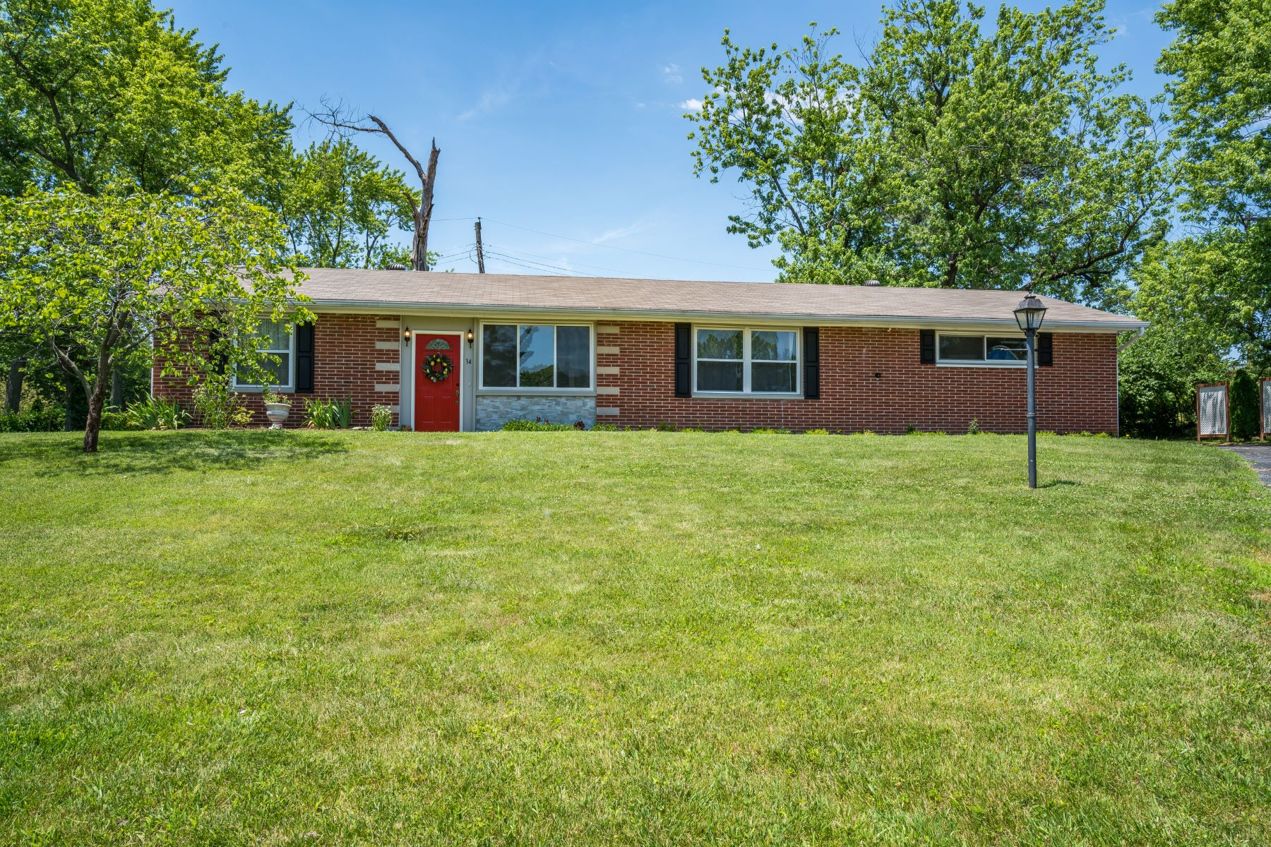 Single Family Homes for Sale at Beautifully Renovated Brick Ranch in Ladue 34 Crabapple Court St. Louis, Missouri 63132 United States
