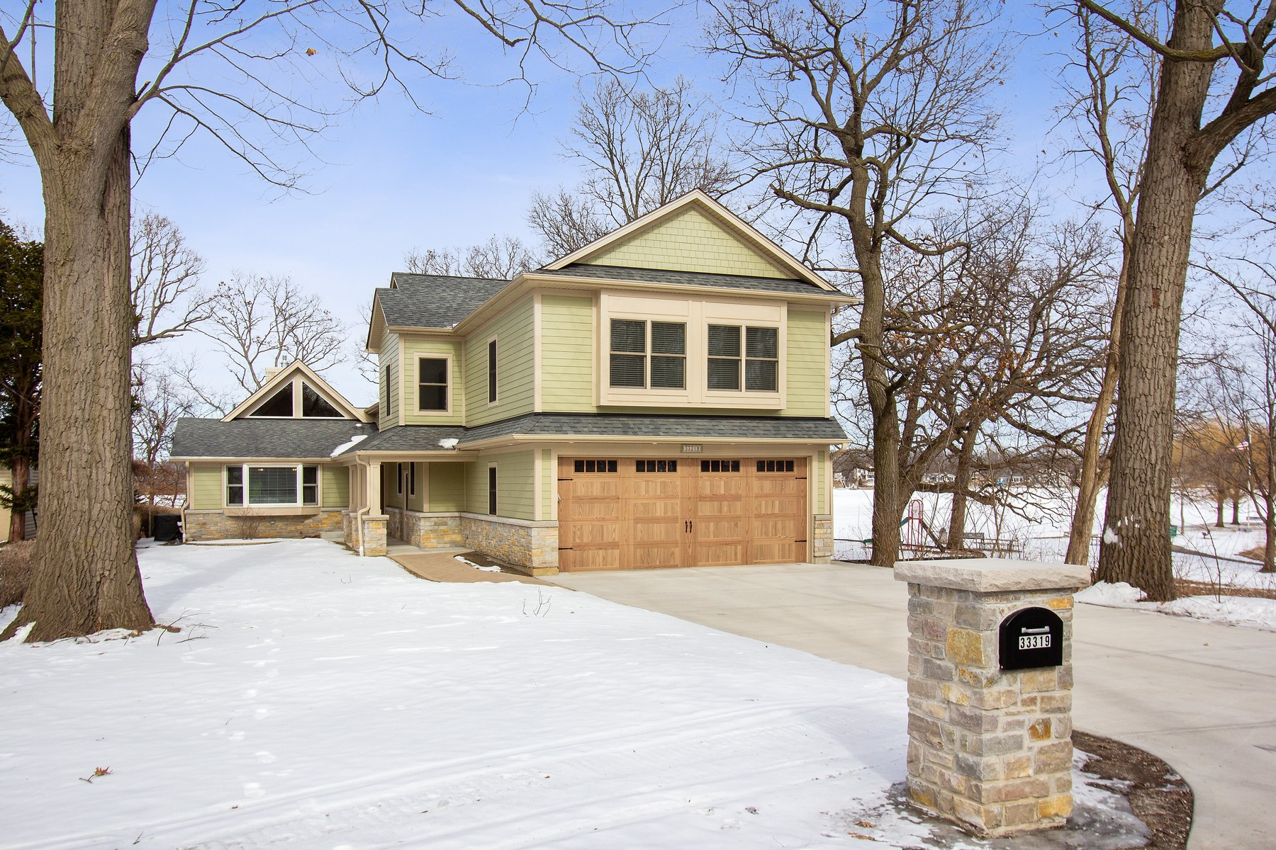 Single Family Home for Sale at Stunning Lakefront Home 33319 N Rule Court Wildwood, Illinois 60030 United States