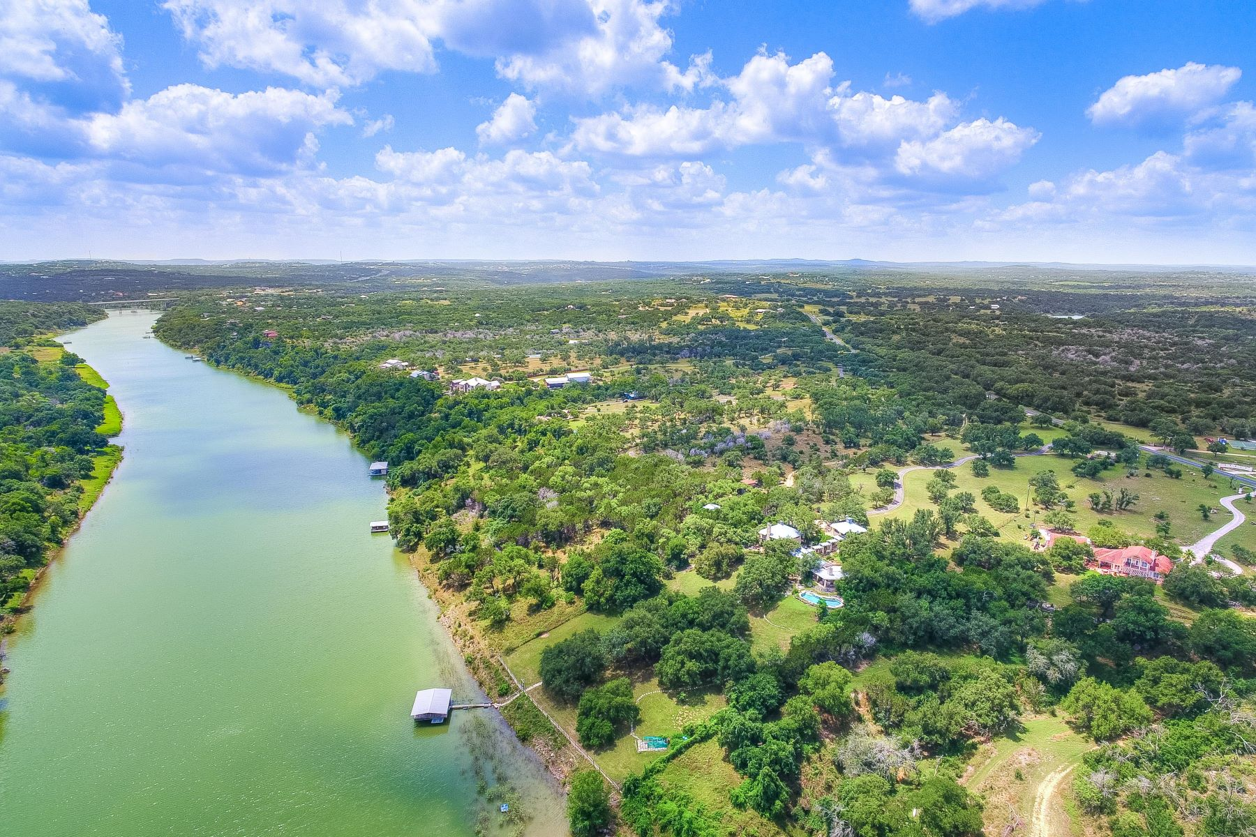 Single Family Homes for Sale at Tranquil Waterfront Estate on the Pedernales River 25014 Pedernales Canyon Trail Spicewood, Texas 78669 United States