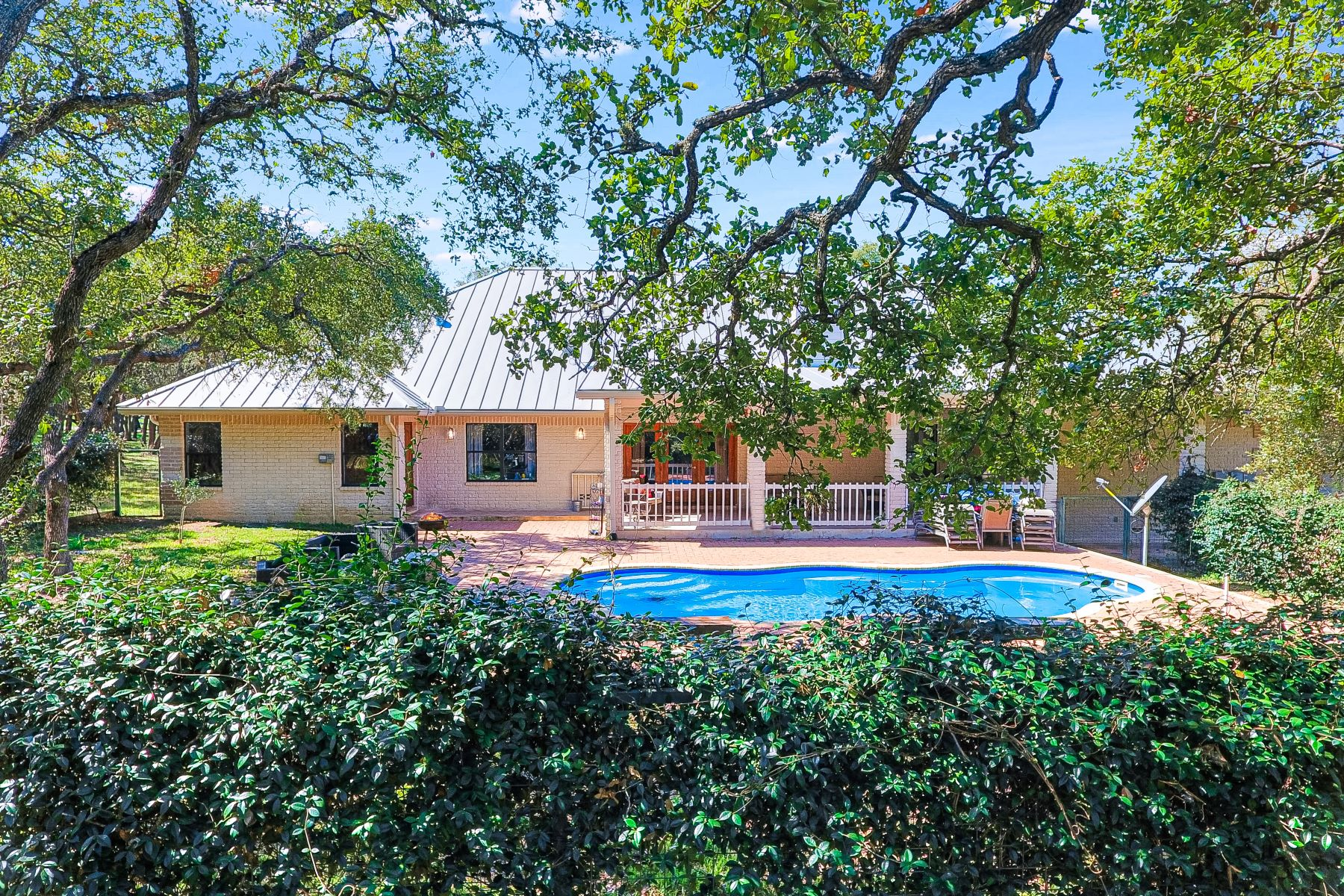 Single Family Homes for Sale at Three Acre Lot with Beautiful Oak Tree Surrounded Pool and Guest House 23970 Cavern Oak Garden Ridge, Texas 78266 United States