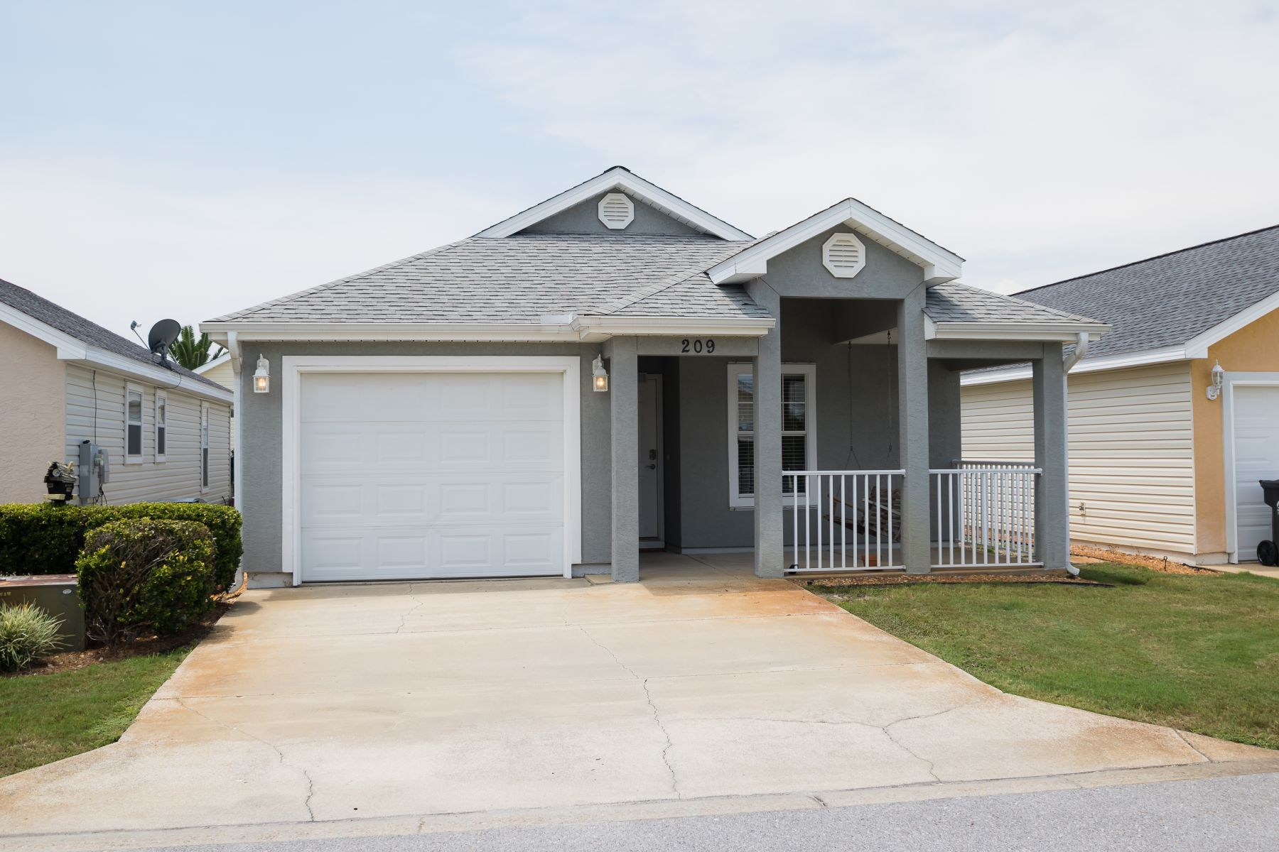 Single Family Homes for Sale at Palm Cove Beach Home Close to Pier Park 209 Seahorse Way, Panama City Beach, Florida 32407 United States