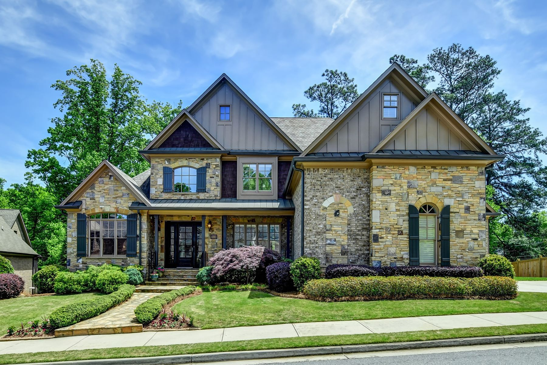 Single Family Home for Sale at Classic Brick and Stone Beauty in a Gated Community and Quiet Cul-de-sac 5385 High Point Manor Atlanta, Georgia 30342 United States