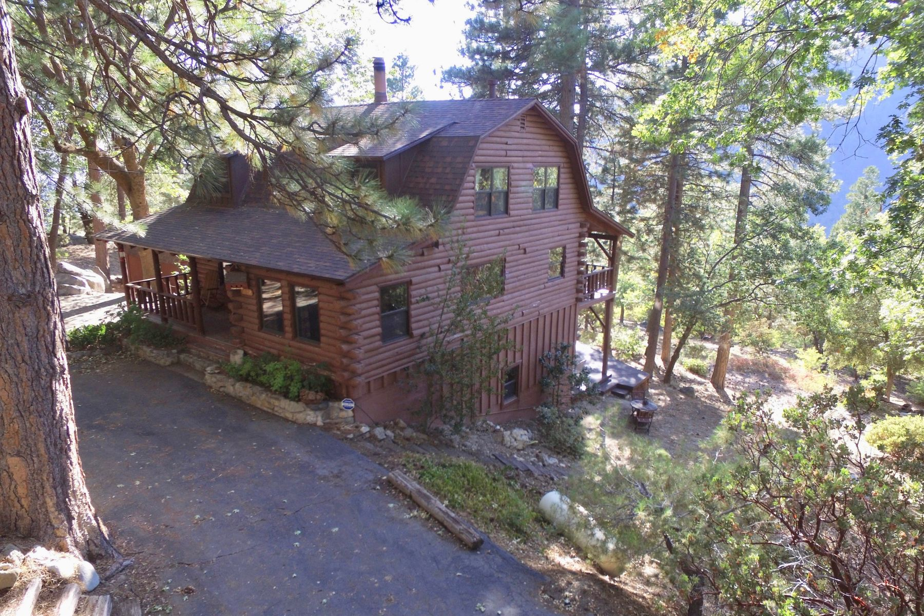 Single Family Homes for Sale at Unique Log Cabin in Wooded Hillside 6452 Cedar Avenue Angelus Oaks, California 92305 United States